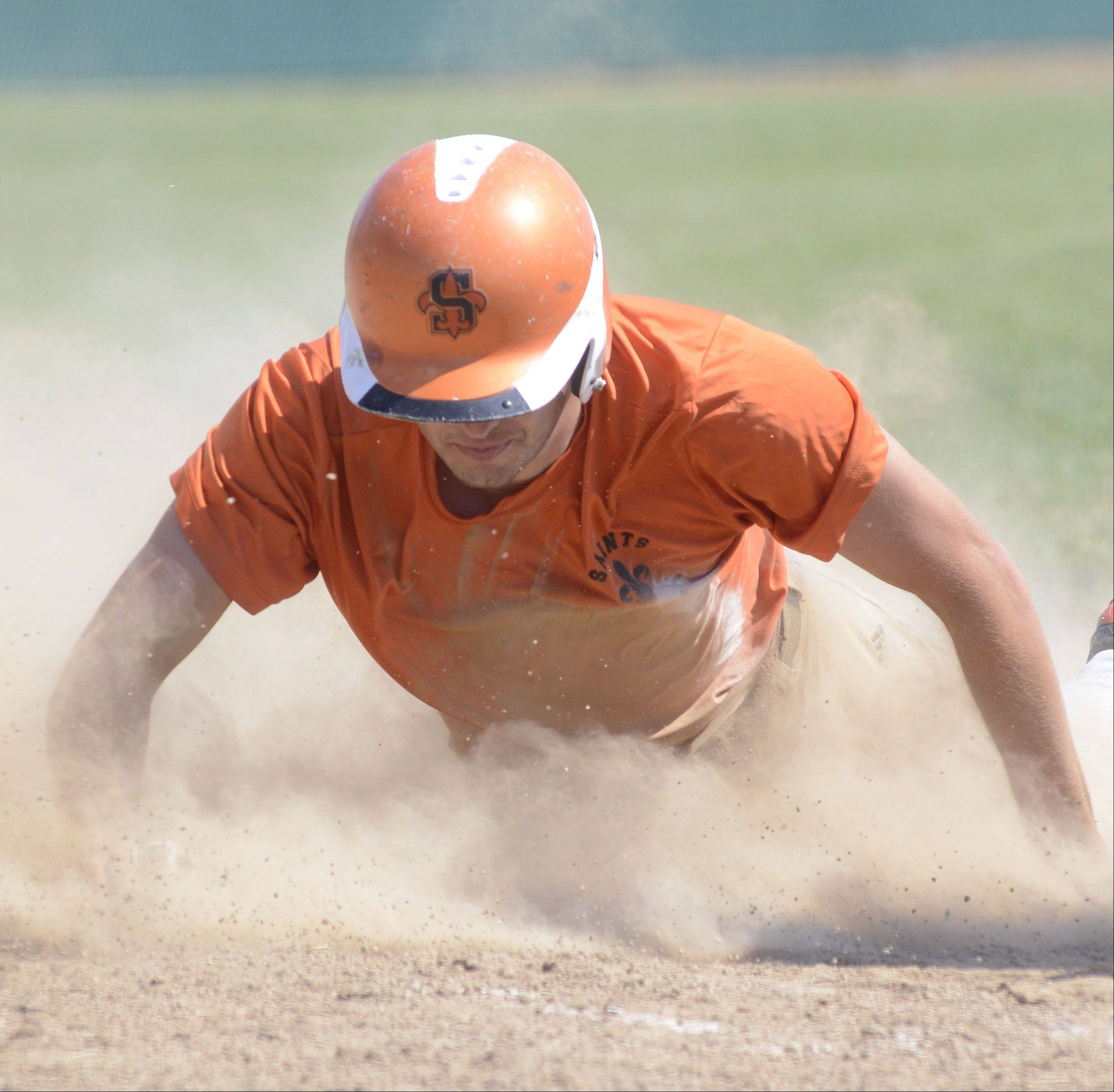 St. Charles East's Alex Abate slides face-first into home plate in the third inning to score the first run in the tournament semifinals vs. St. Charles North's on Wednesday, July 17.