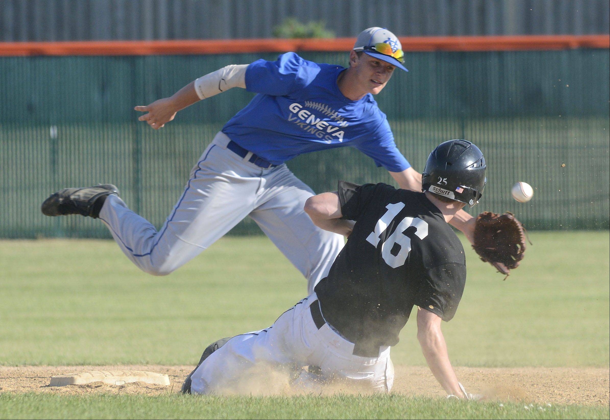 Geneva's Jack Wassel reaches for the ball as Batavia's Steve Busby slides safely into second base Wednesday.