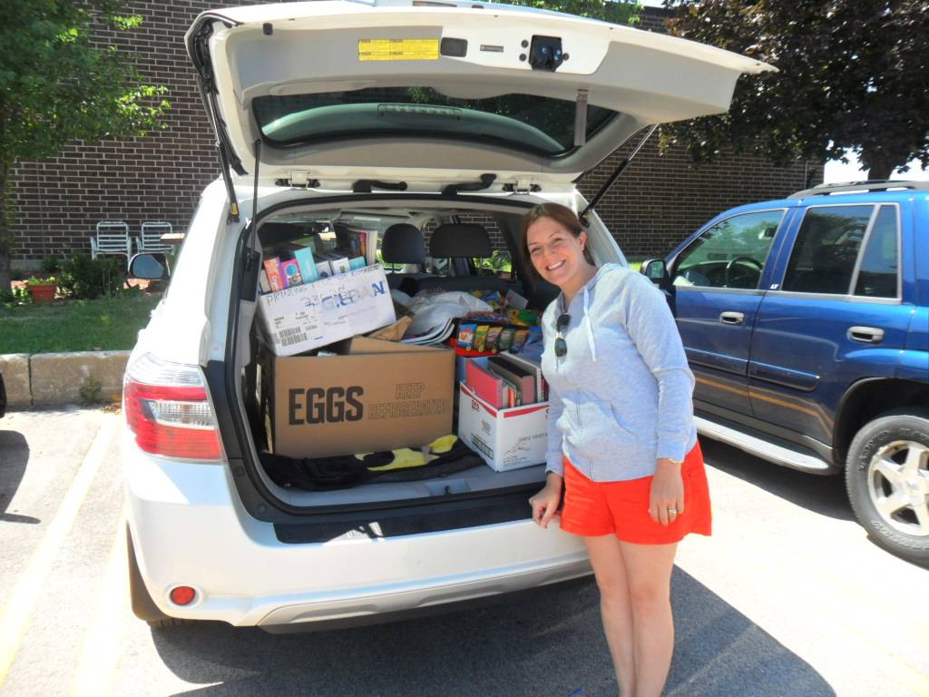 Nicole Gdowski dropped off eight boxes of school supplies/arts and crafts on Friday, July 12, 2013 at Humanitarian Service Project.