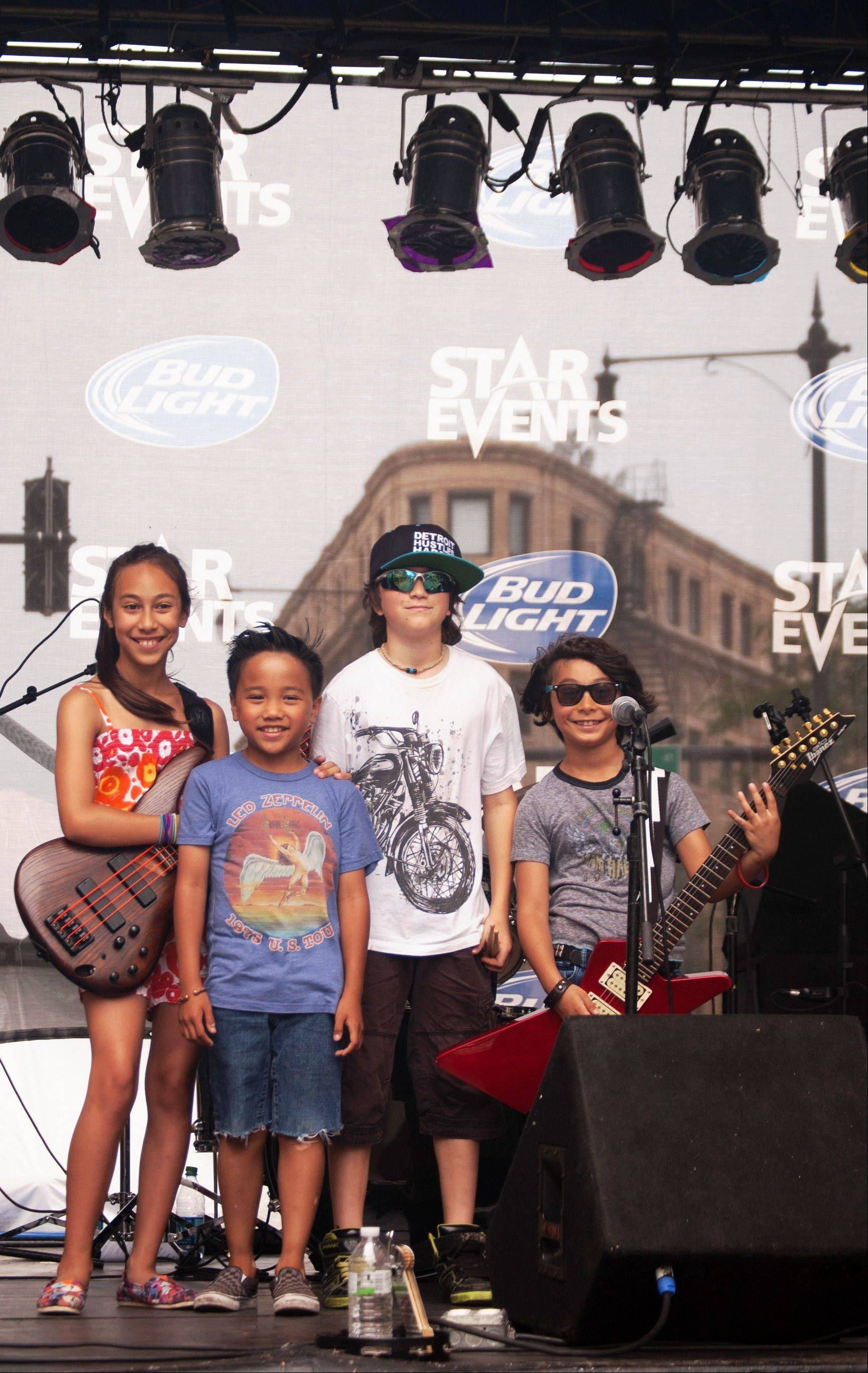 "LiveWire formed about 1� years ago, and performs a repertoire of songs by rock and pop artists. The band includes bassist Alexandra ""Alex"" Cappelli, 10, of Geneva; lead vocalist Nikko Viejon, 8, of North Aurora; drummer Cohen Bessler, 10, of St. Charles; and guitarist Danny Cappelli, 8, of Geneva."