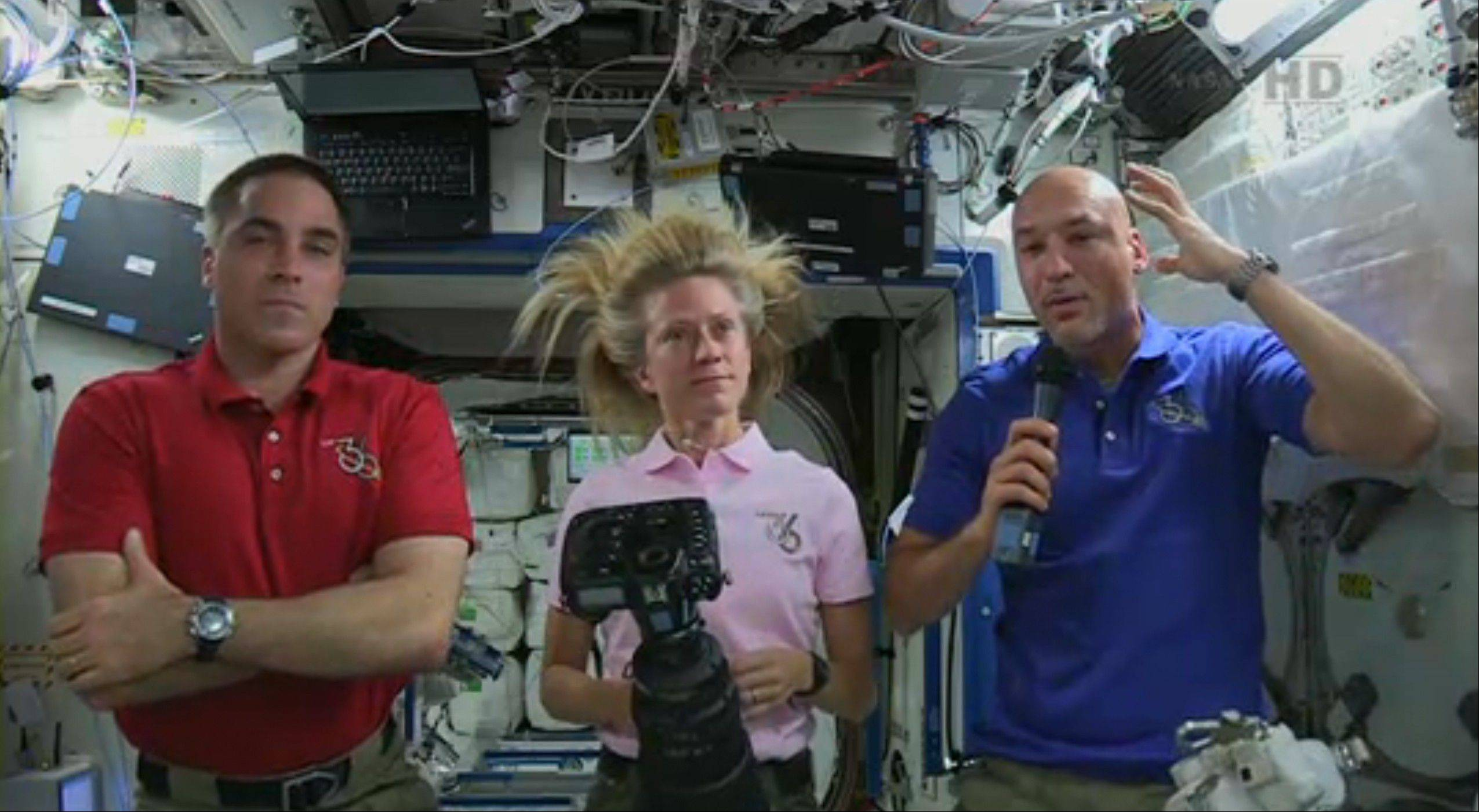 In this image from video made available by NASA, Italian astronaut Luca Parmitano, right, describes the water in his helmet during Tuesday�s spacewalk. He could not hear or speak by the time he re-entered the space station because of the big globs of water in his helmet and elsewhere in his suit.