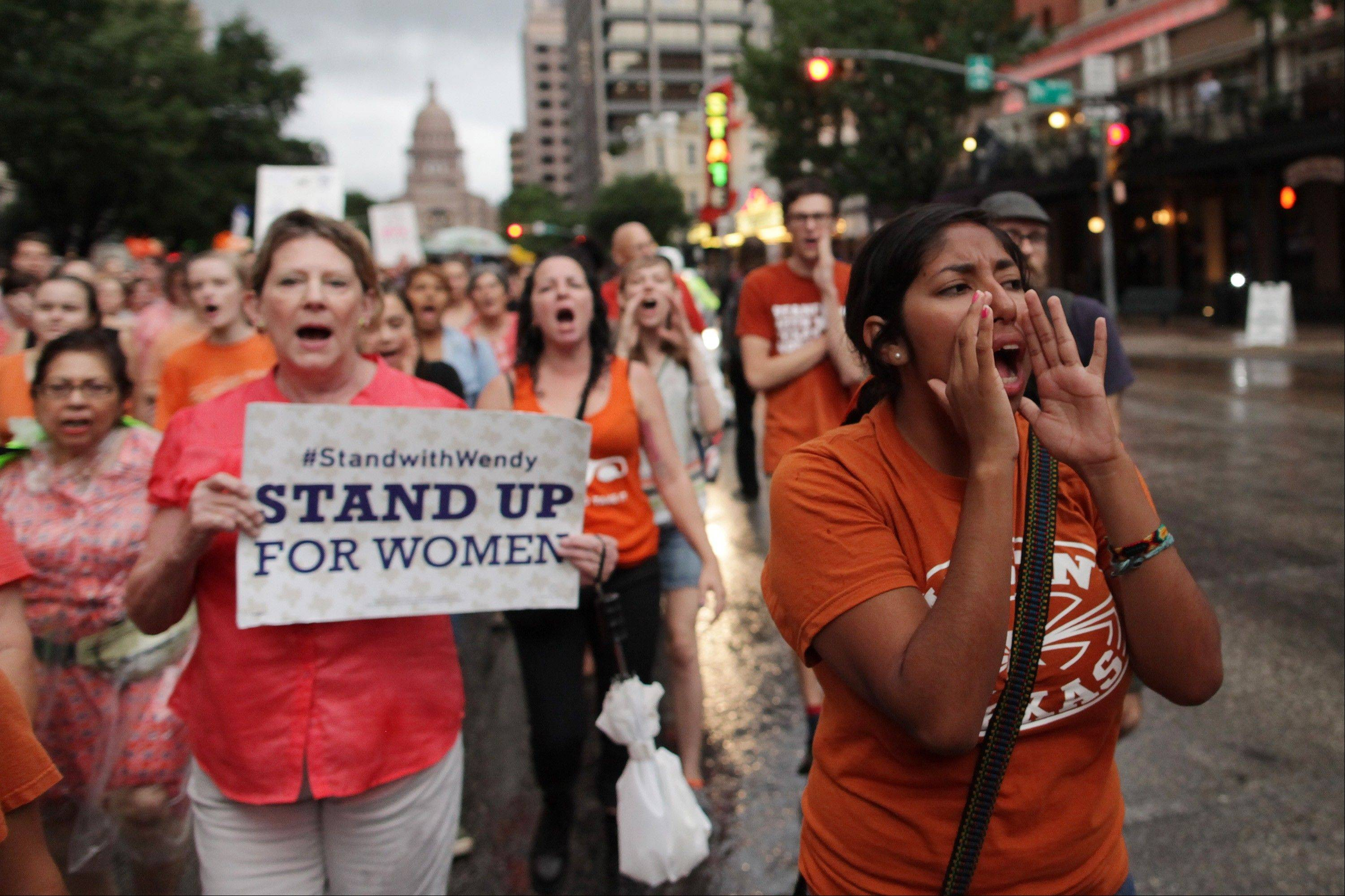 Abortion rights advocates march down Congress Ave. to protest recent legislation that could shut down all but five abortion clinics and restrict abortion rights throughout the state in Austin, Texas on Monday, July 15, 2013.