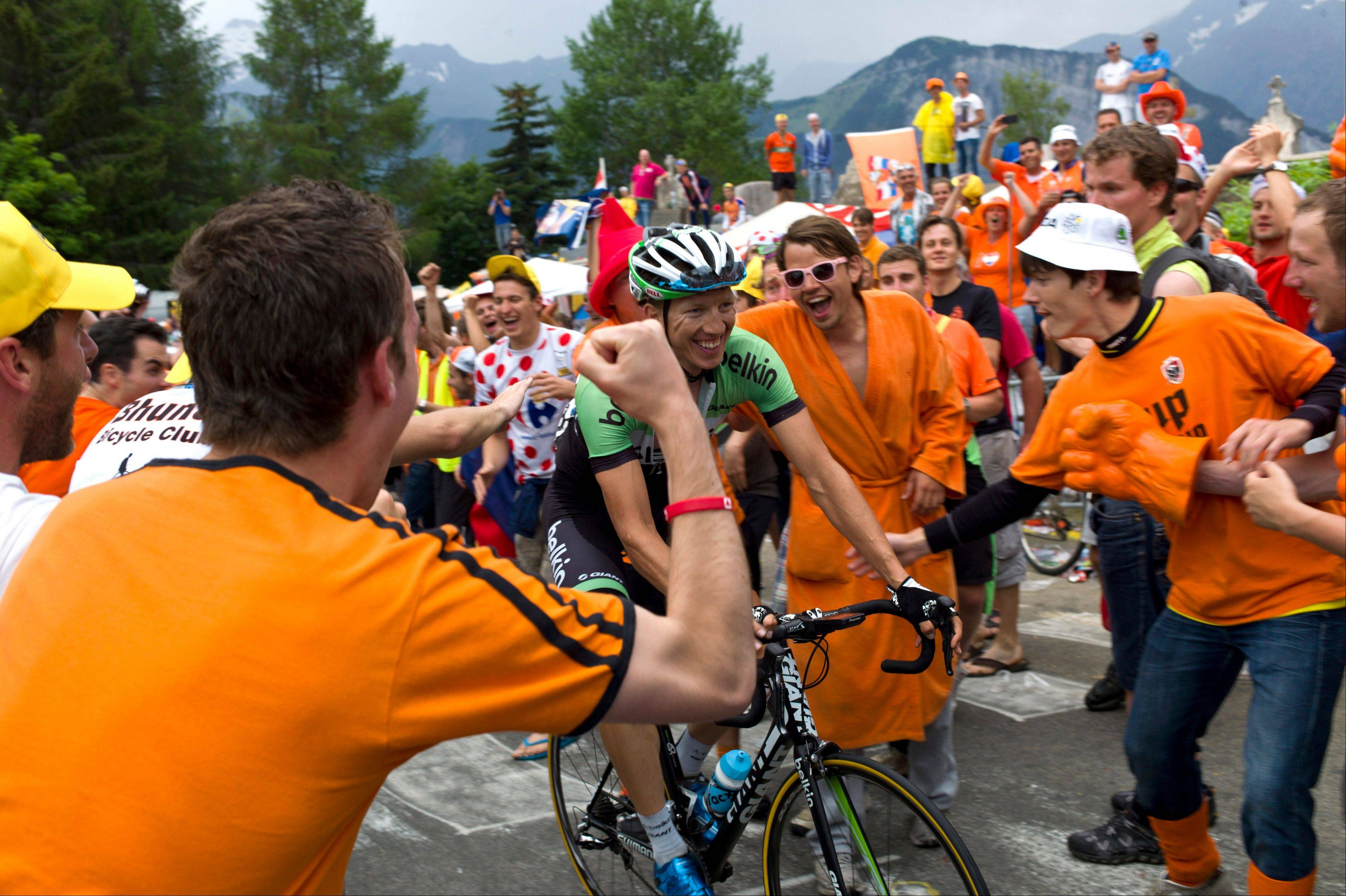 Dutch cycling fans cheers as Sep Vanmarcke of Belgium passes curve number 7, also known as the Dutch curve during the eighteenth stage of the Tour de France cycling race over 172.5 kilometers (107.8 miles) with start in Gap and finish in Alpe-d'Huez, France, Thursday July 18, 2013. (AP Photo/Thibault Camus)