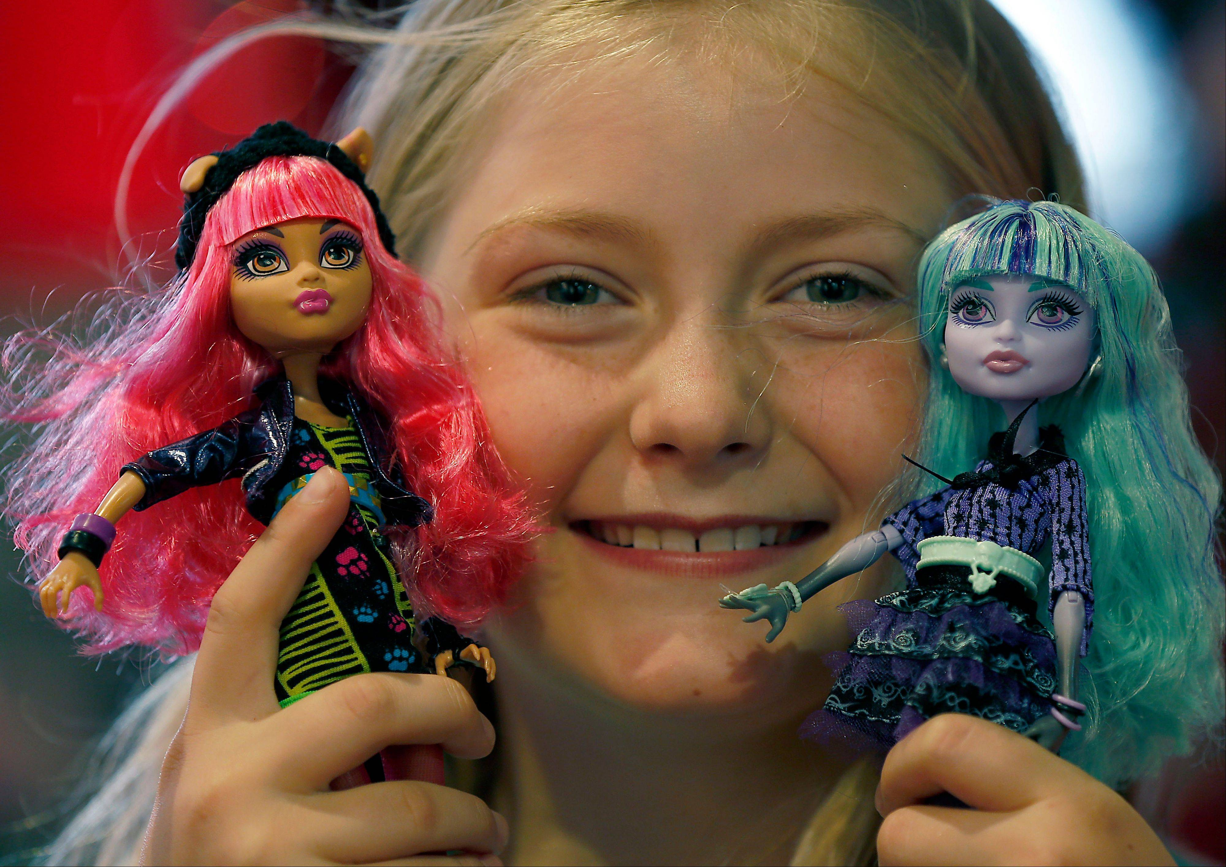Tegan, 9, with her Monster High Dolls. Mattel's Monster High Dolls, with neon hair and punk clothing, have grown to an estimated $500 million in annual sales.