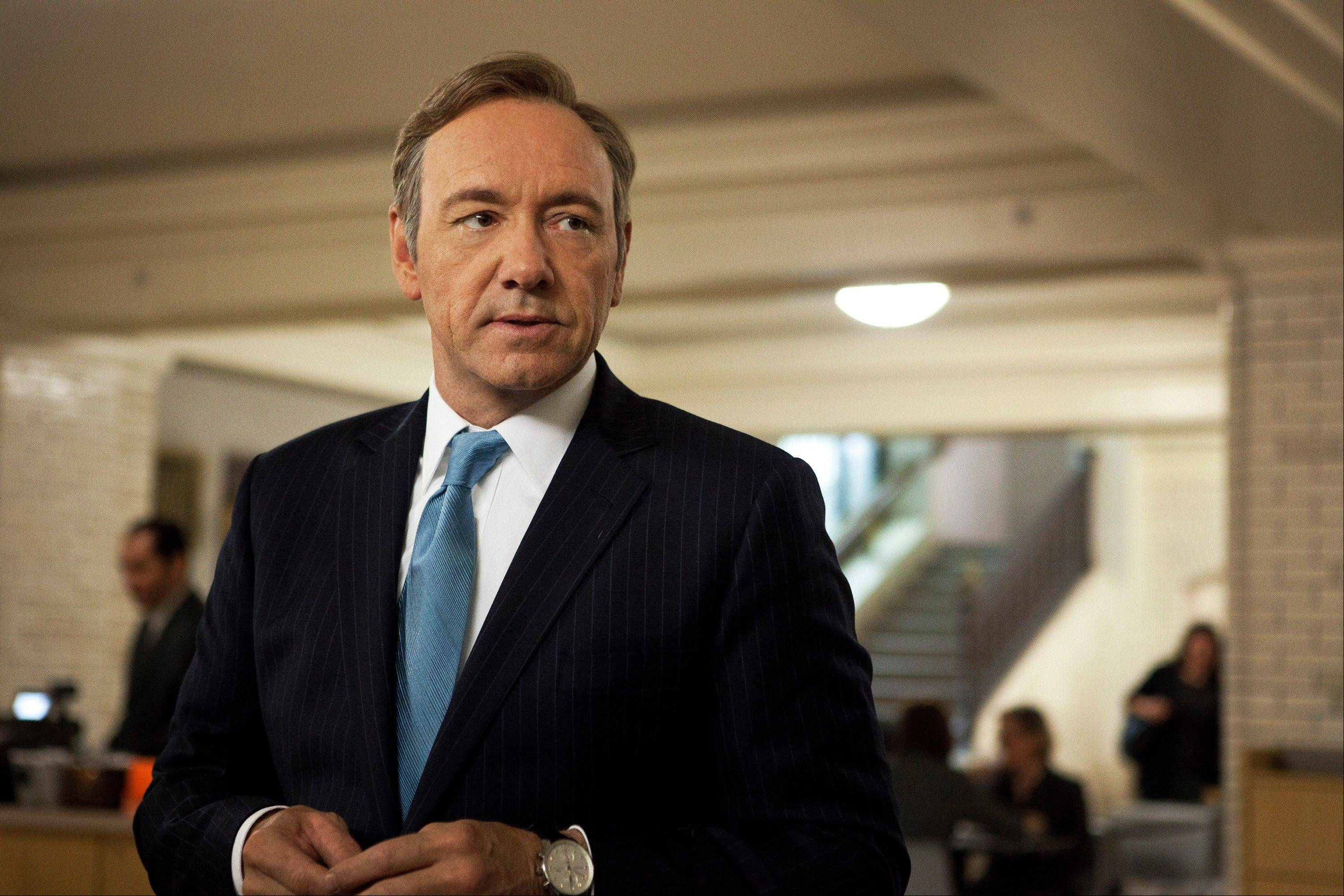 "Kevin Spacey plays U.S. congressman Frank Underwood in the Netflix original series, ""House of Cards."" The political intrigue saga received a best drama series nomination Thursday. It's the first top Emmy nod for a program delivered online, not on TV."