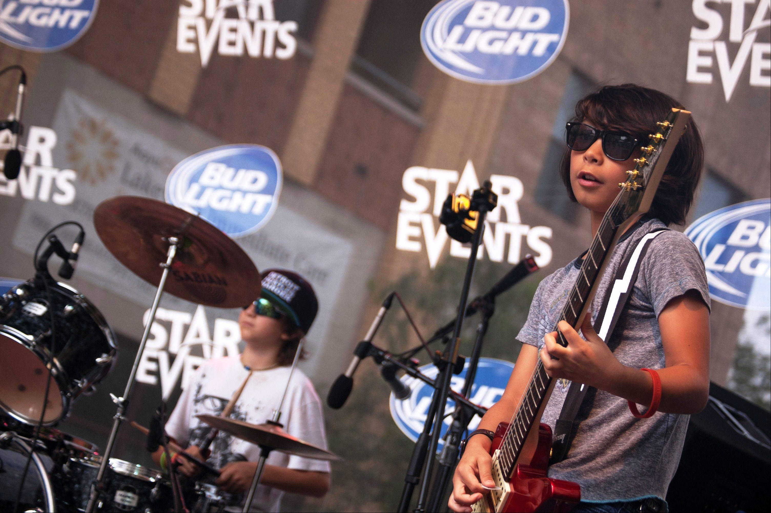 Drummer Cohen Bessler, 10, of St. Charles, and guitarist Danny Cappelli, 8, of Geneva, during LiveWire's performance July 6 at Taste of Lakeview in Chicago.