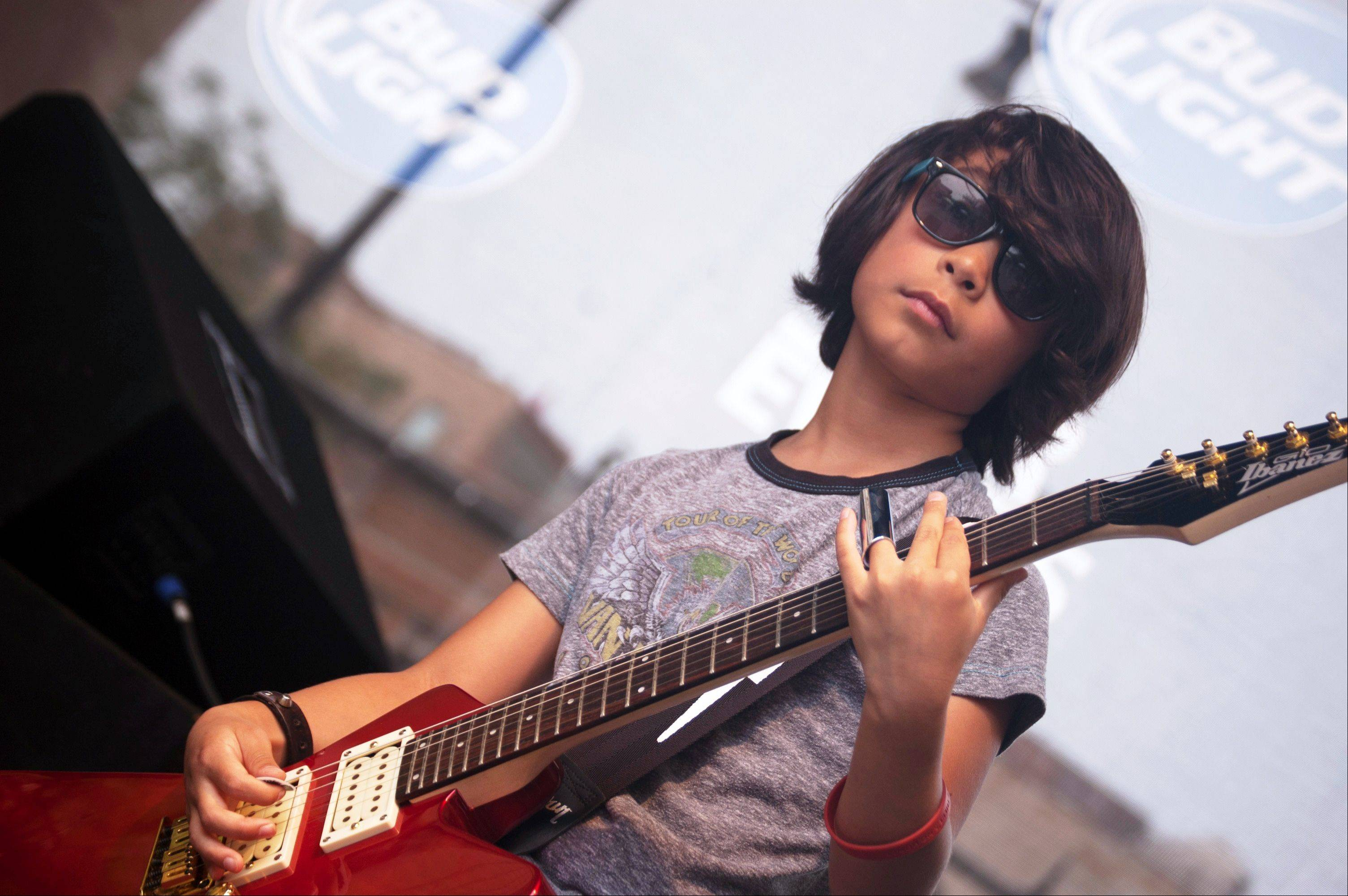 Guitarist Danny Cappelli, 8, of Geneva, during LiveWire's performance July 6 at Taste of Lakeview in Chicago.