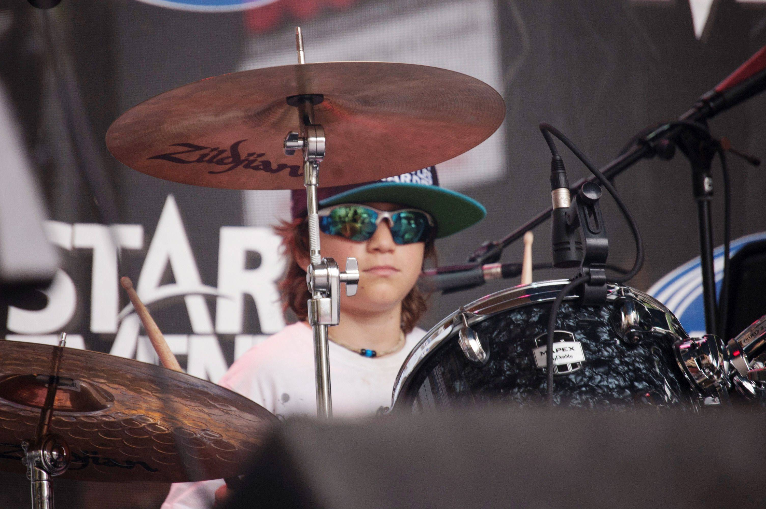 Drummer Cohen Bessler, 10, of St. Charles, during LiveWire's performance July 6 at Taste of Lakeview in Chicago.