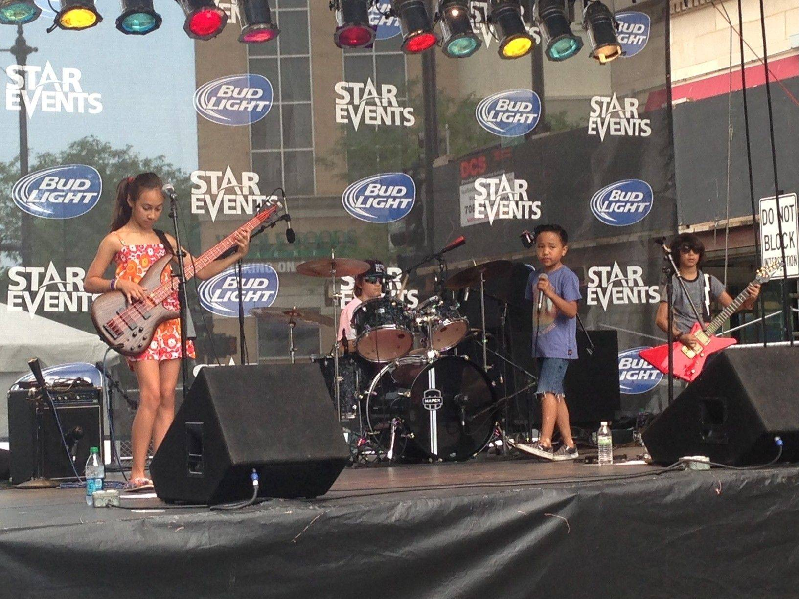 "LiveWire formed about 1½ years ago, and performs a repertoire of songs by rock and pop artists. The band includes bassist Alexandra ""Alex"" Cappelli, 10, of Geneva; lead vocalist Nikko Viejon, 8, of North Aurora; drummer Cohen Bessler, 10, of St. Charles; and guitarist Danny Cappelli, 8, of Geneva."
