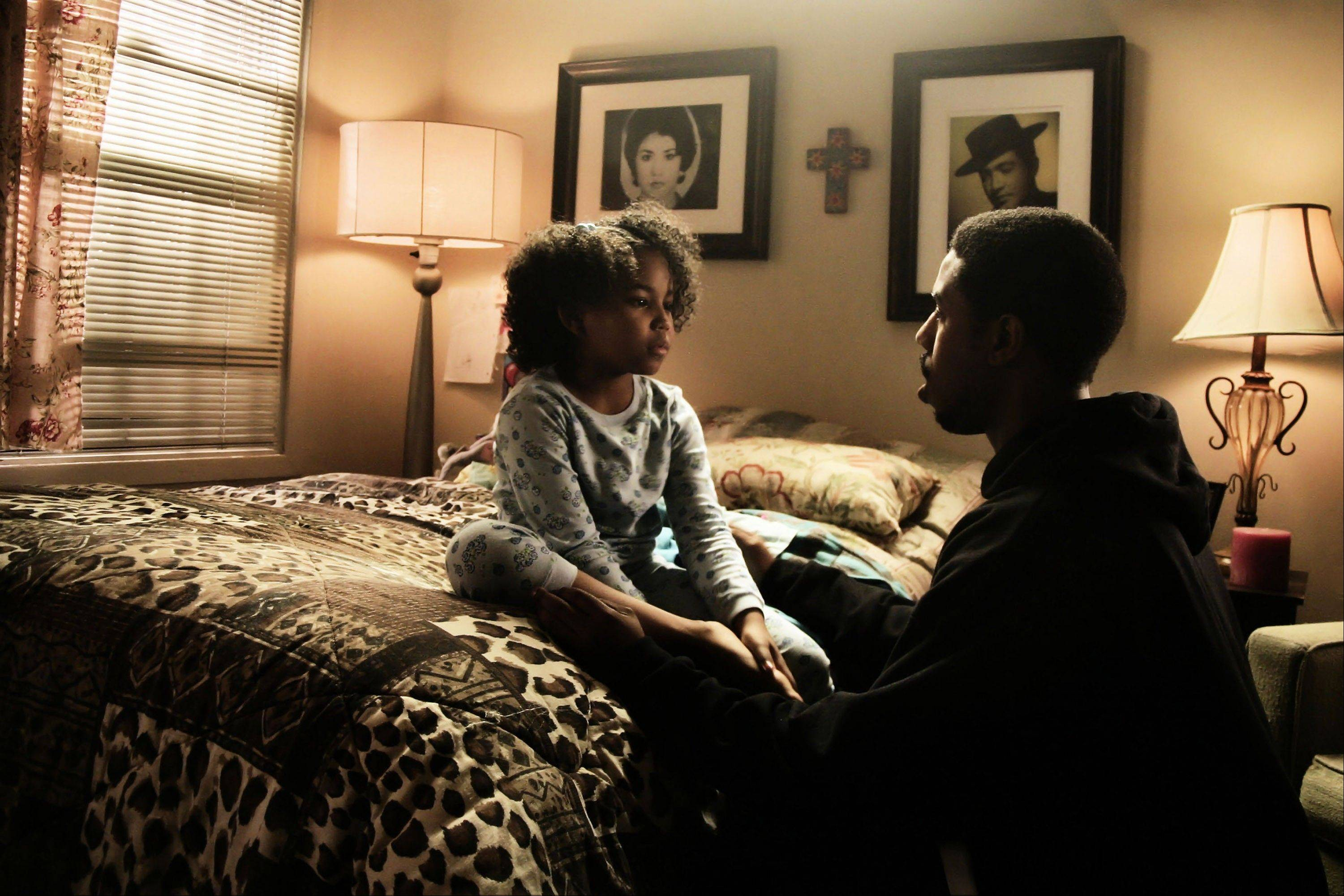 "Oscar (Michael B. Jordan) shares a moment with his daughter Tatiana (Ariana Neal) in ""Fruitvale Station."""
