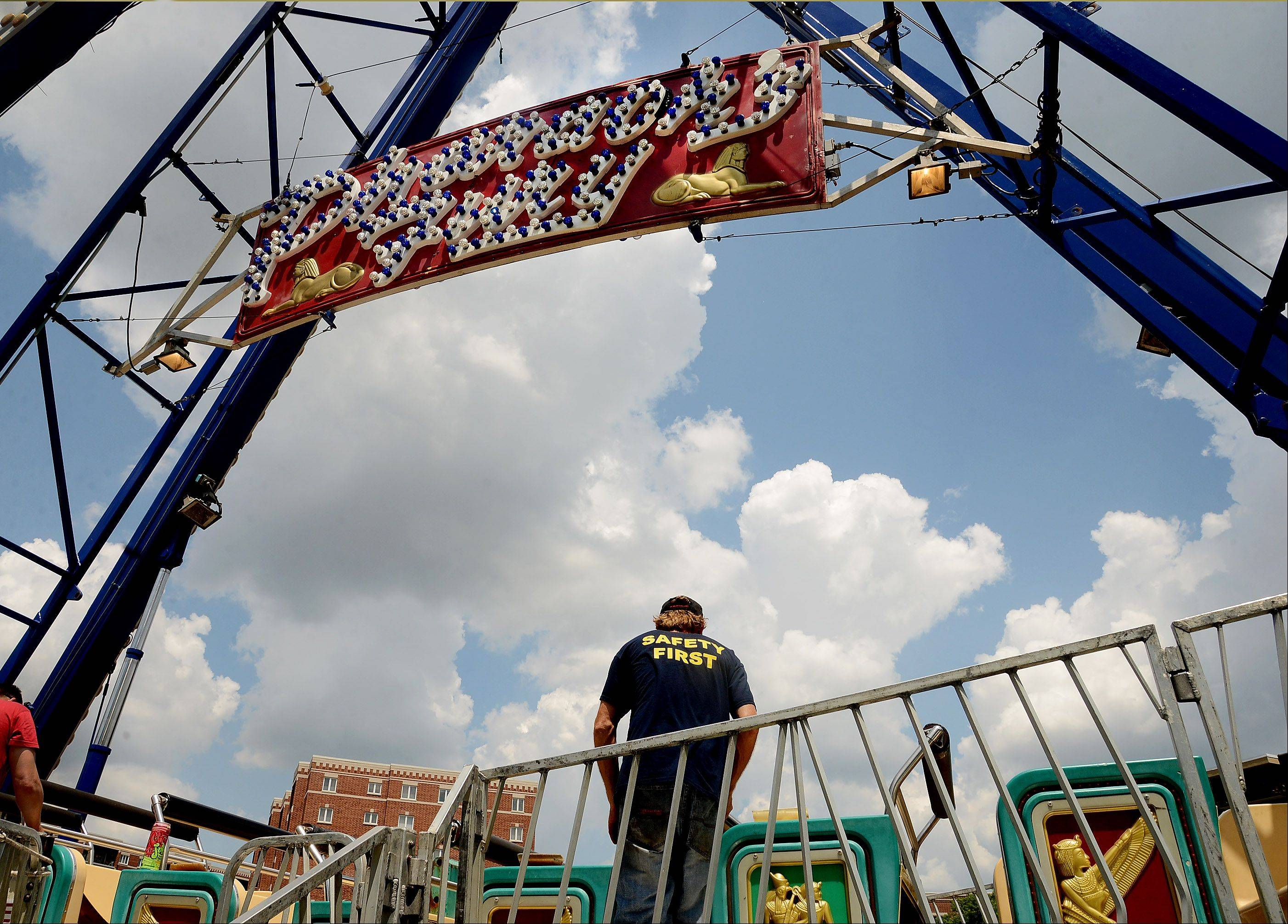 Maintenance man Greg Etheridge of D&J Amusements sets up the Pharaoh's Fury ride Thursday in preparation for Des Plaines Summer Fling in downtown Des Plaines. The three-day festival highlighted by live music, food, games and carnival rides kicks off Friday.
