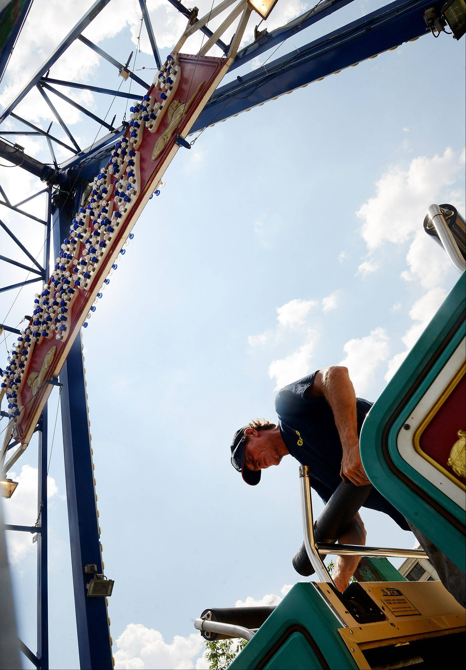Maintenance man Greg Etheridge of D&J Amusements sets up the Pharaoh's Fury ride in preparation for Des Plaines Summer Fling in downtown Des Plaines. The three-day festival highlighted by live music, food, games and carnival rides kicks off Friday.