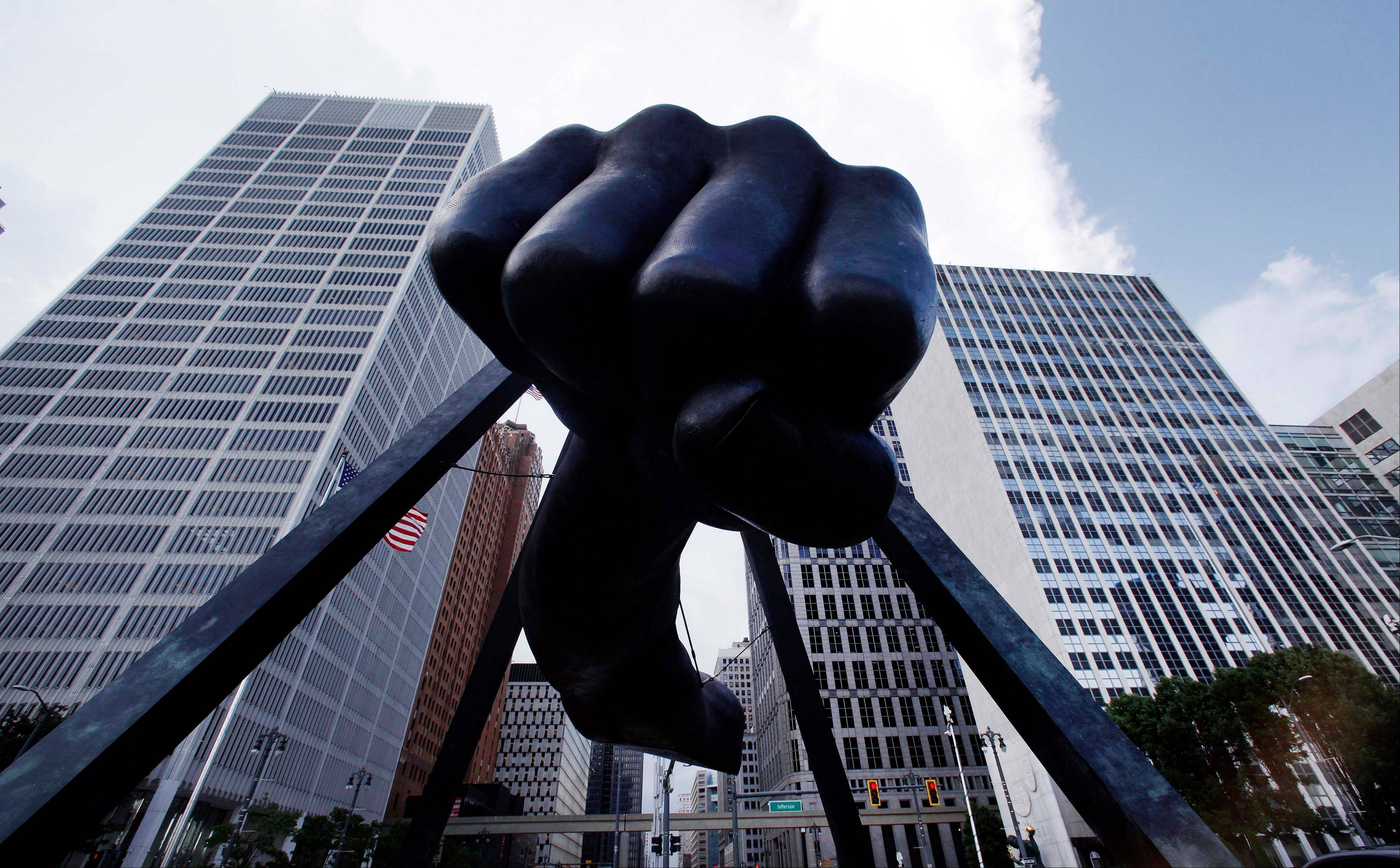 "The Detroit skyline rises behind the Monument to Joe Louis, also known as ""The Fist,"" Thursday. State-appointed emergency manager Kevyn Orr asked a federal judge permission to place Detroit into Chapter 9 bankruptcy protection."