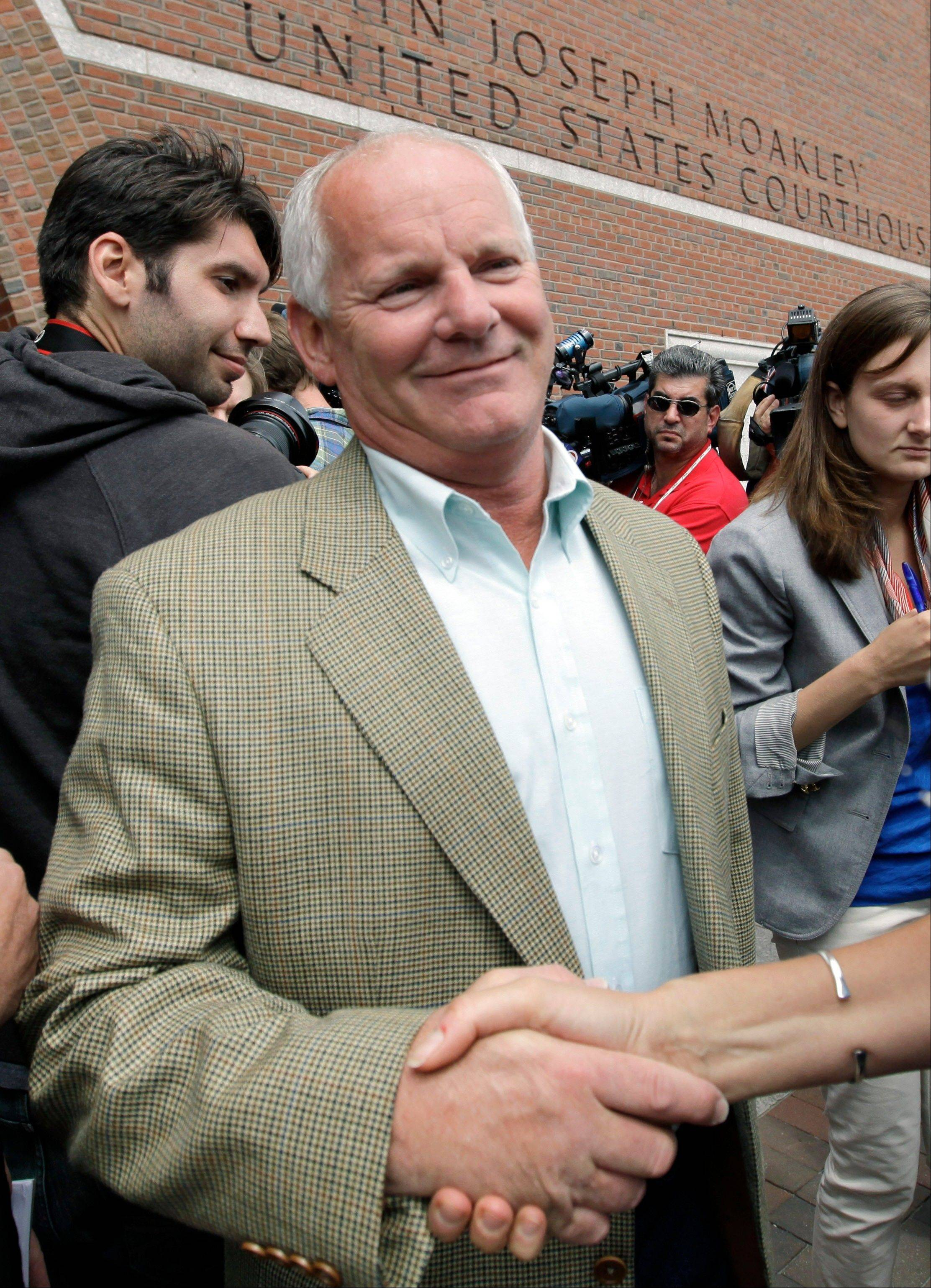 In this Tuesday, June 12, 2012 photo Stephen Rakes receives a handshake outside federal court in Boston.