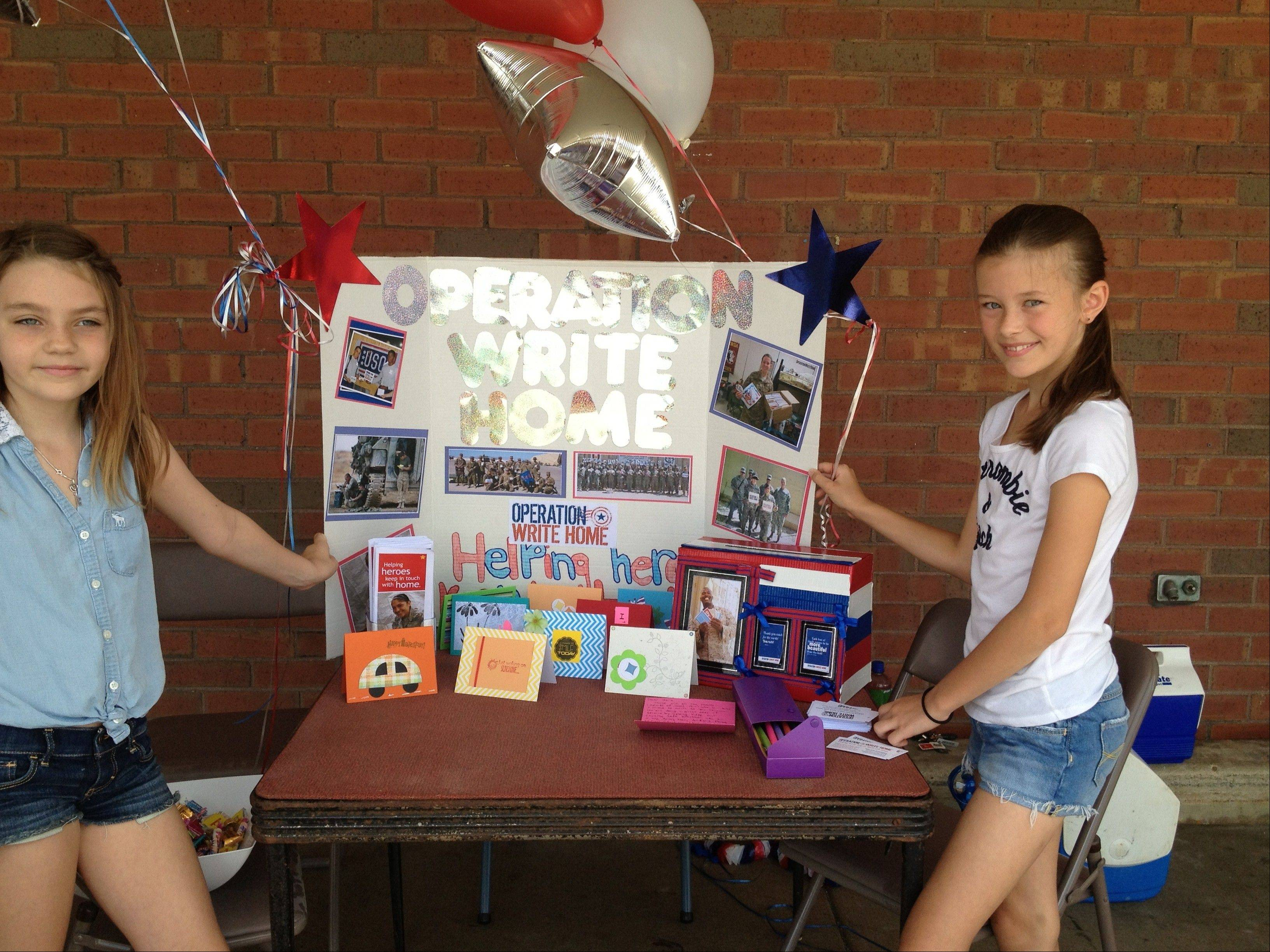Gianna Greco, left, and Olivia Messerges, both 10-year-olds from Hoffman Estates, have spent time this summer creating blank cards as part of Operation Write Home. The cards are sent to military personnel overseas, who then can use them to write to their families back home.