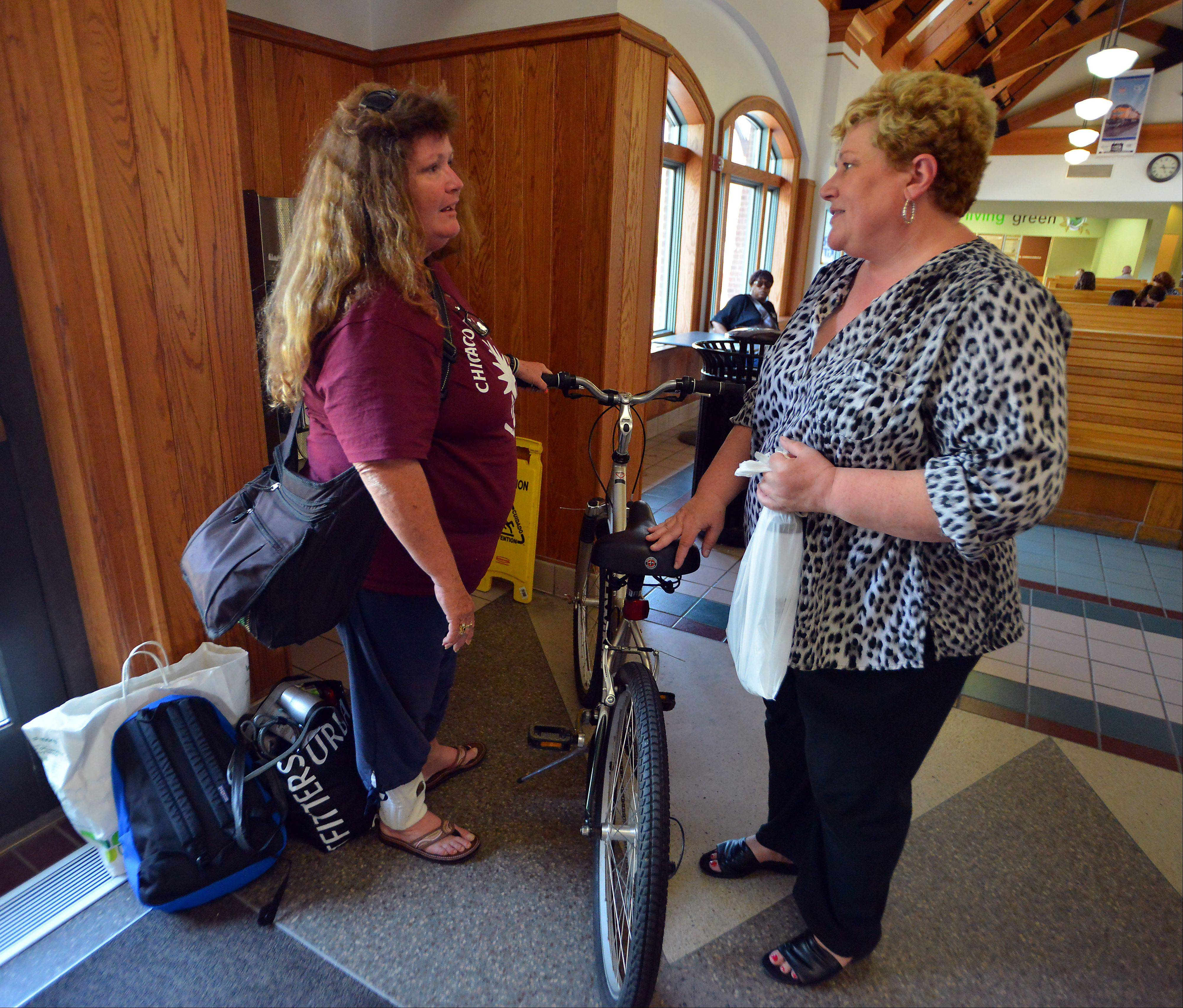 Kathy Kelly of Hoffman Estates, right, and Rosan Acosta are all smiles after Kelly donated her Schwinn bike to Acosta.