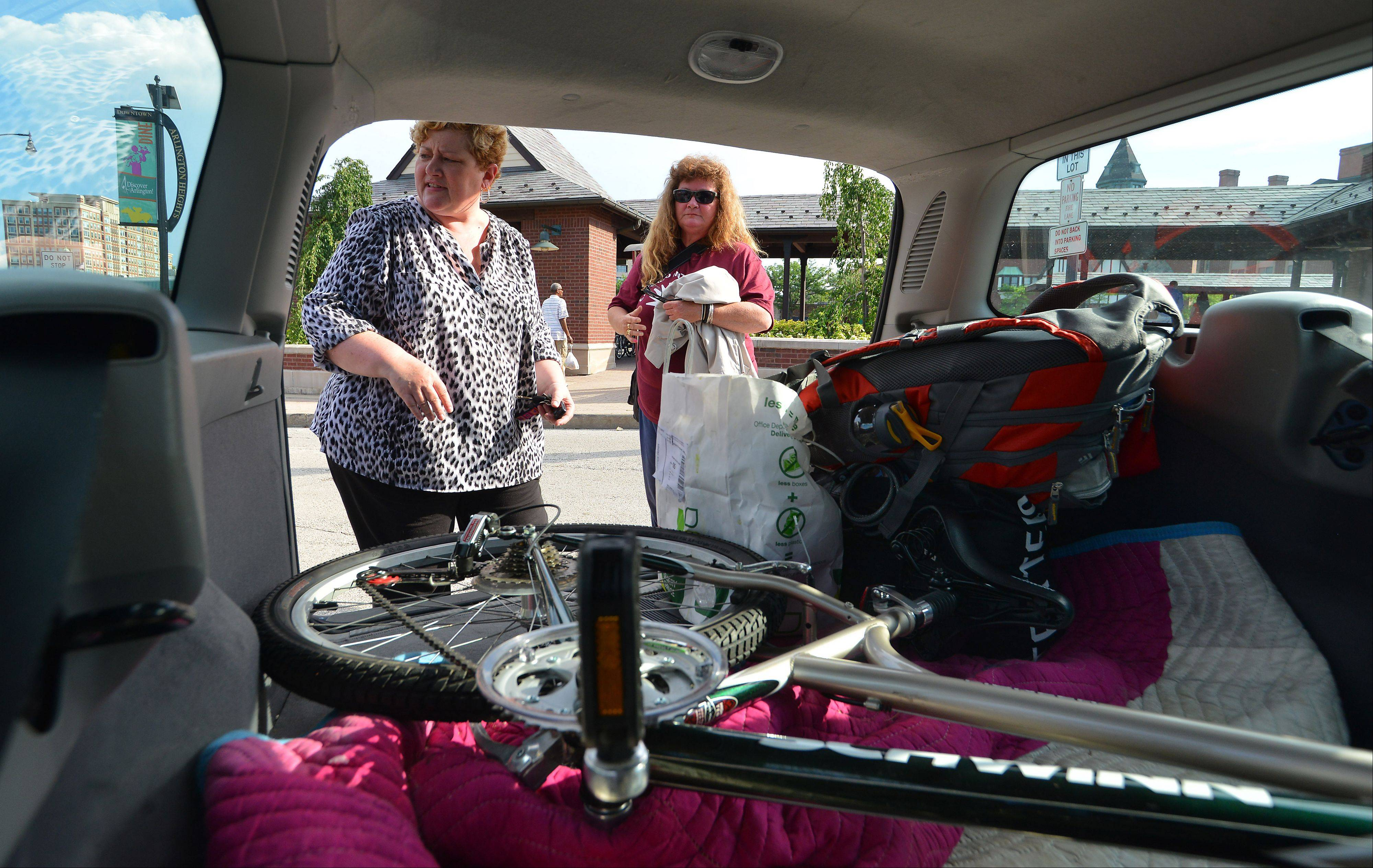 Kathy Kelly of Hoffman Estates, left, loads the bike and belongings into her car, before the two women went to get something to eat.