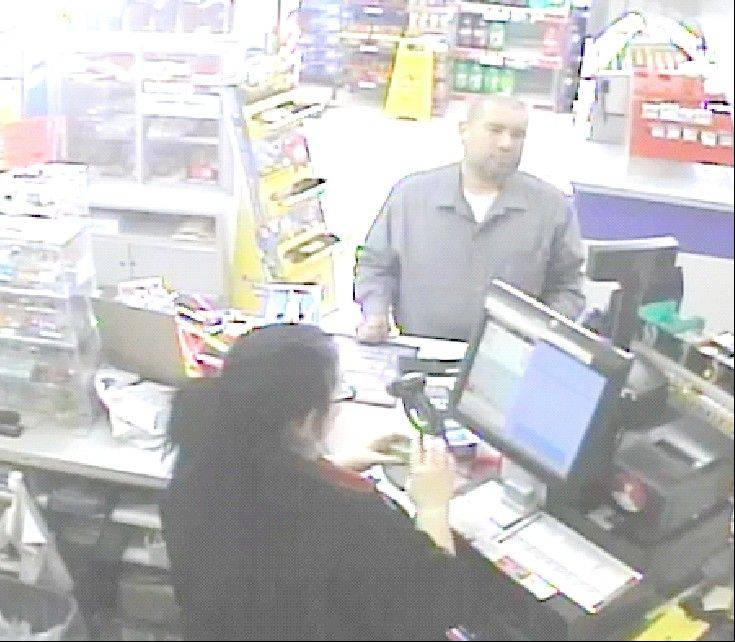 This photo made from a surveillance camera on May 12, 2013, shows a person resembling Dr. Anthony Garcia making a purchase at a Casey's General Store in Council Bluffs, Iowa, which is just east of Omaha. Garcia has been arrested on suspicion of killing four people in Omaha, Neb., with ties to the Creighton medical school in two separate attacks five years apart.
