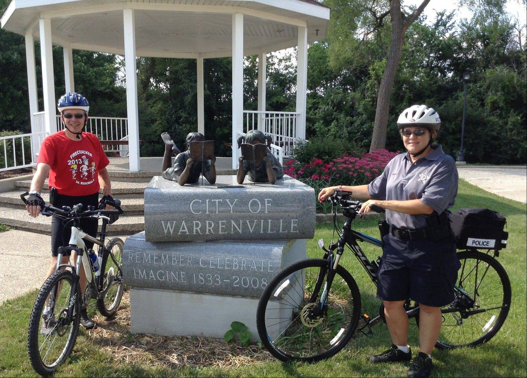 Warrenville police officer Teresa McBride, right, and Mayor David Brummel meet Wednesday to mark the start of the city's fledgling police bike patrol program. McBride will spend several hours a week patrolling parks, paths and other hard-to-reach places in Warrenville.