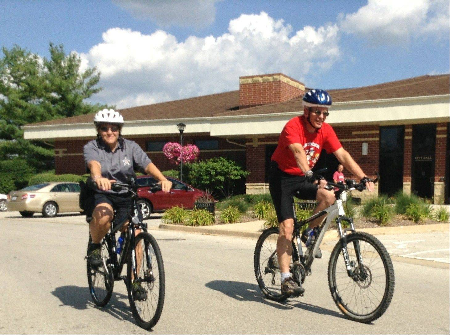 Warrenville Mayor David Brummel, right, and police officer Teresa McBride set off on the city's first bicycle patrol in nearly a decade.
