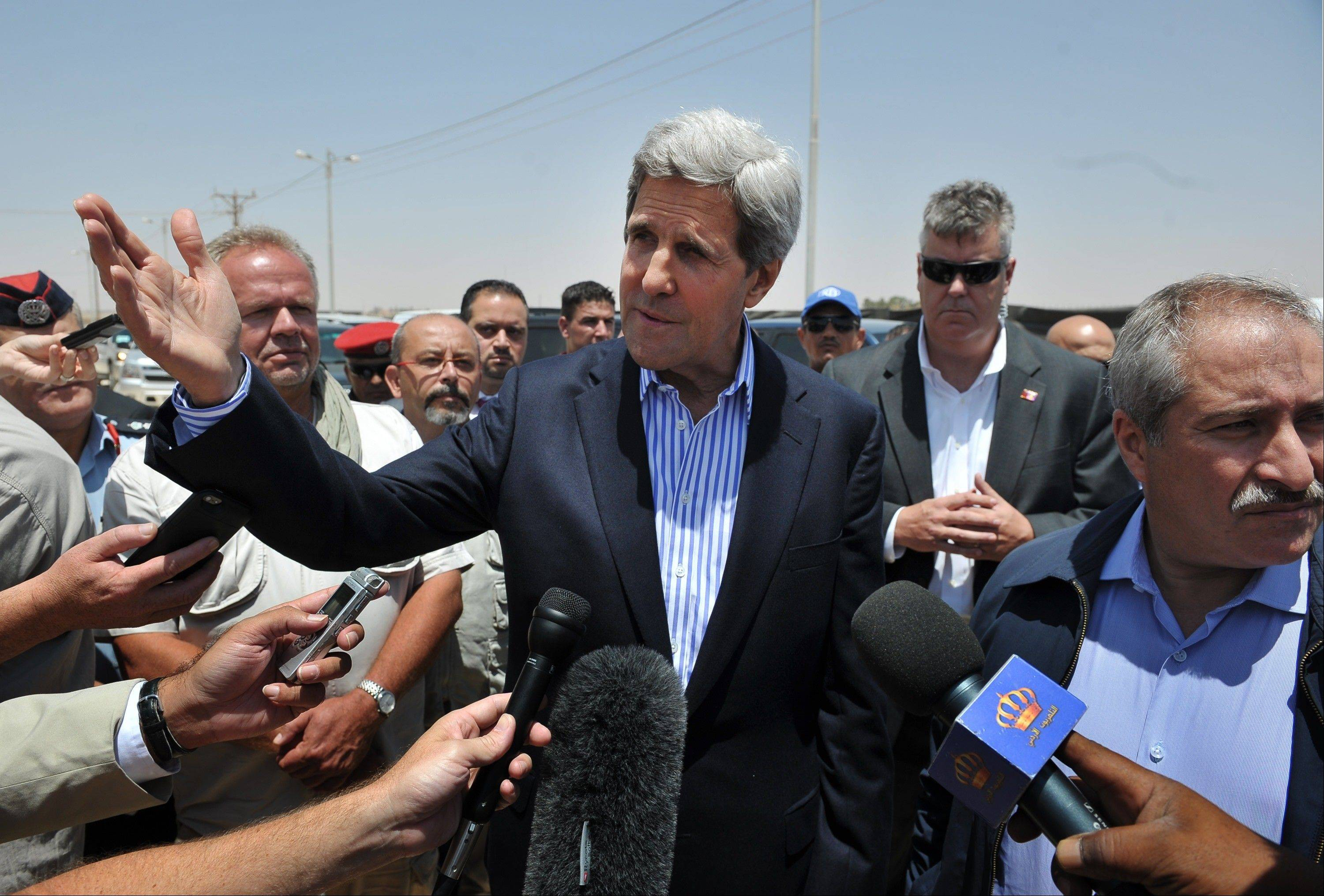 U.S. Secretary of State John Kerry visits the Zaatari refugee camp in Mafraq, Jordan, Thursday, July 18, 2013. Angry Syrian refugees urged Kerry on Thursday to do more to help opponents of President Bashar Assad's government, venting frustration at perceived inaction on their behalf.