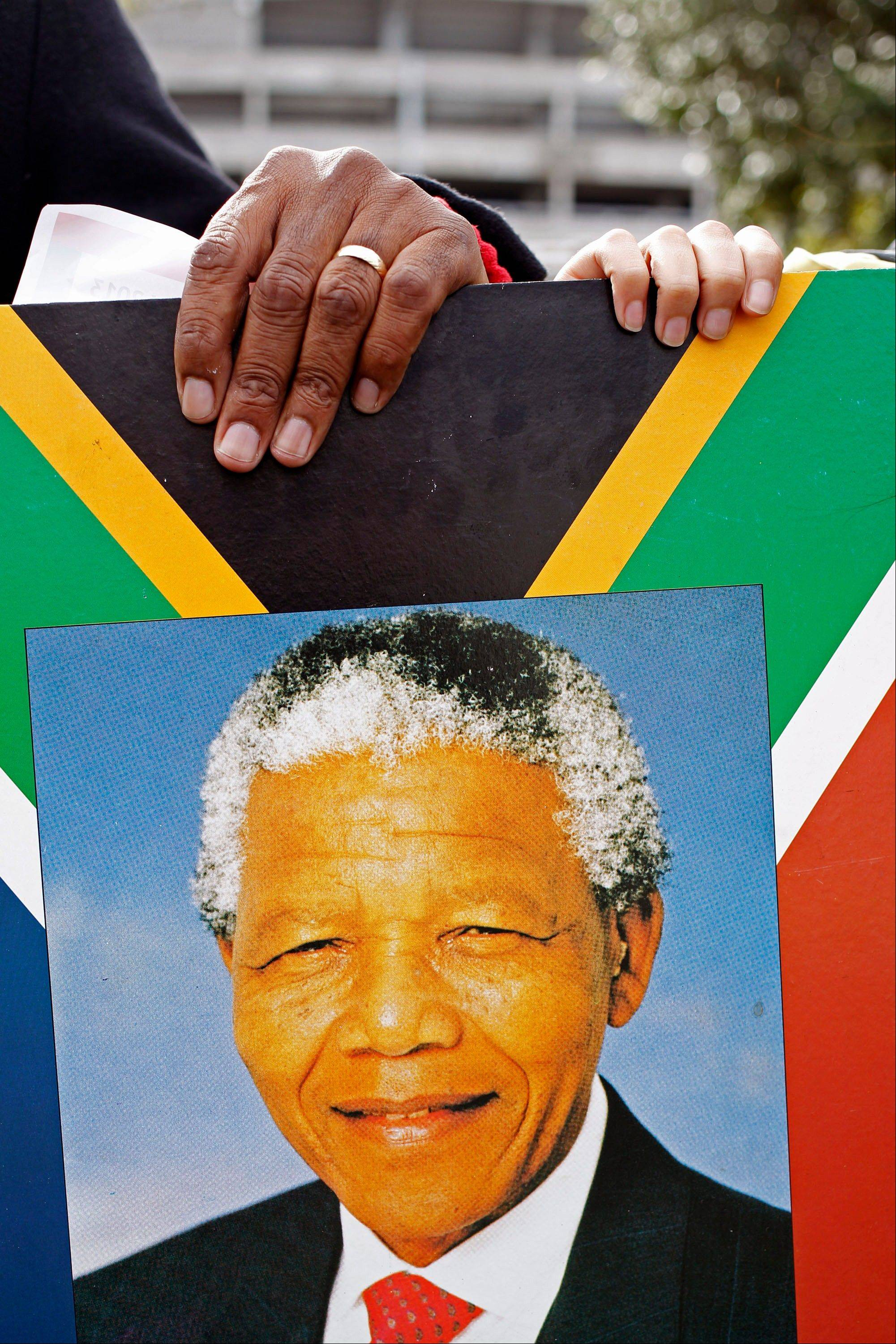 South Africa celebrated Nelson Mandela's 95th birthday on Thursday, a milestone capped by news that the former president's health was improving after fears that he was close to death during ongoing hospital treatment.