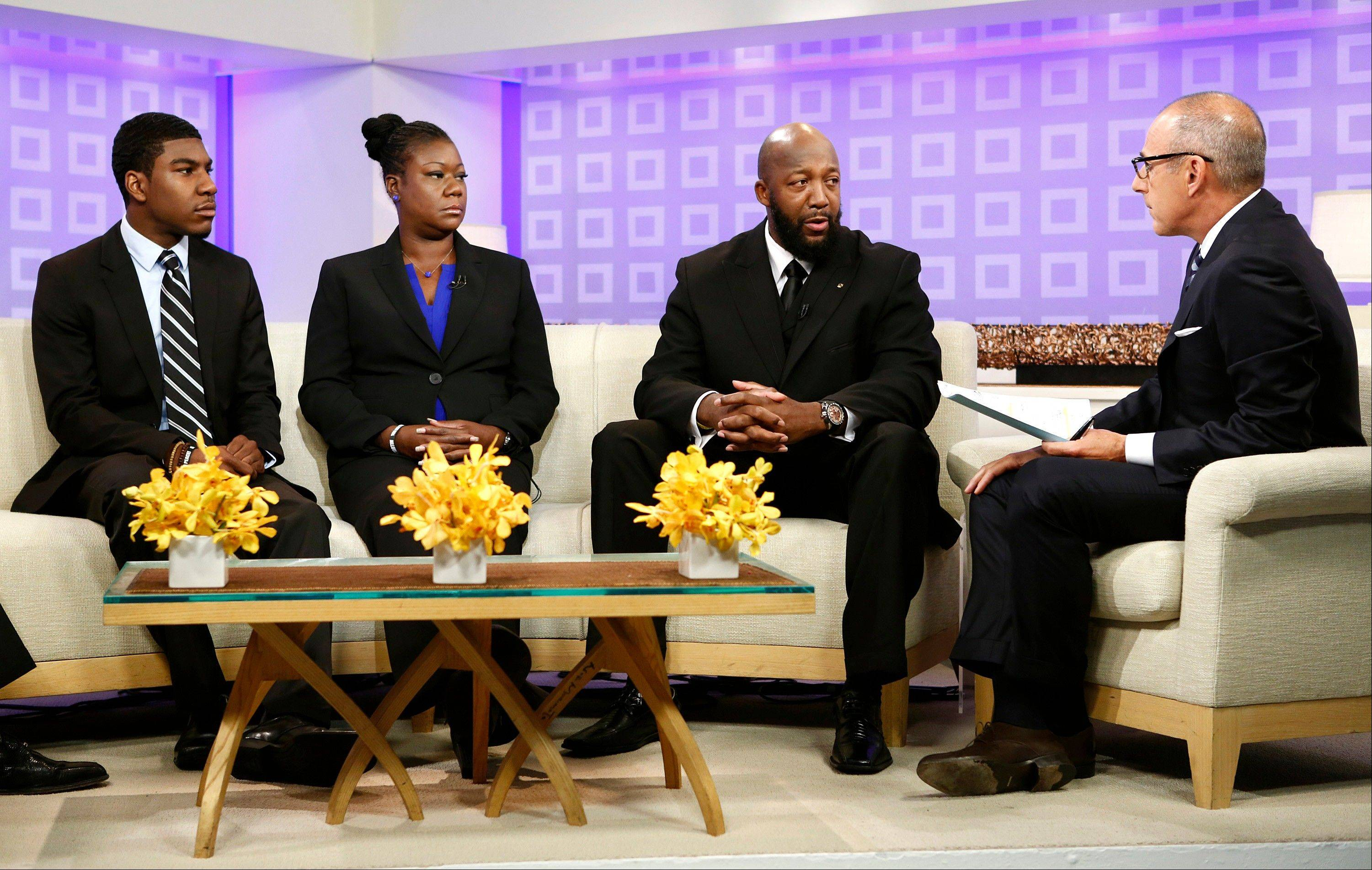 "In this image released by NBC, parents of Trayvon Martin, Sybrina Fulton, second left, and Tracy Martin, second right, appear on the ""Today"" show with Fulton's other son, Jahvaris Fulton, left, and co-host Matt Lauer in New York."