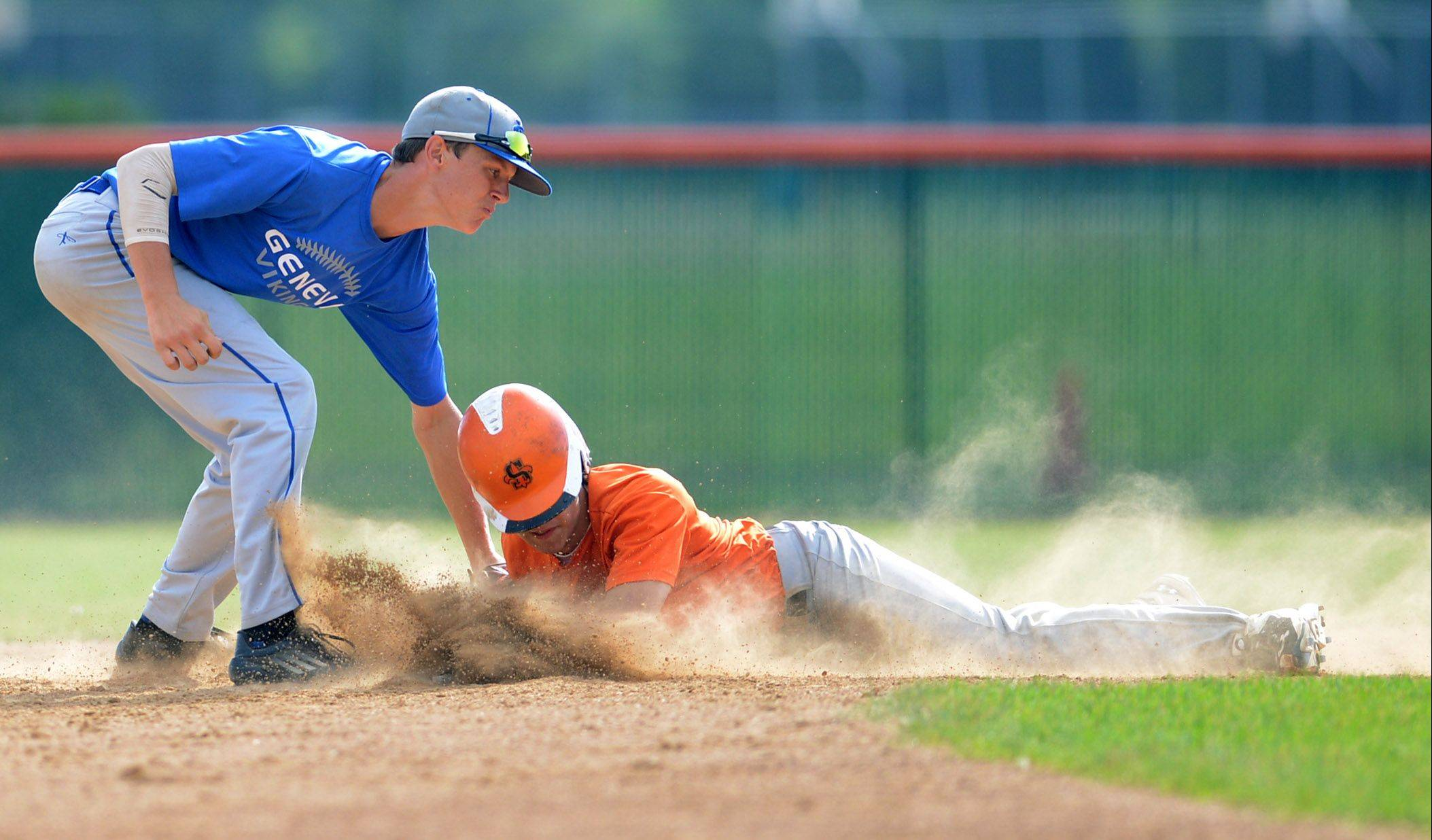 St. Charles East's Austin Regelbrugge slides safely into second in front of the tag of Geneva's Jack Wassel, starting off a 4-run third inning during Thursday's game in St. Charles.