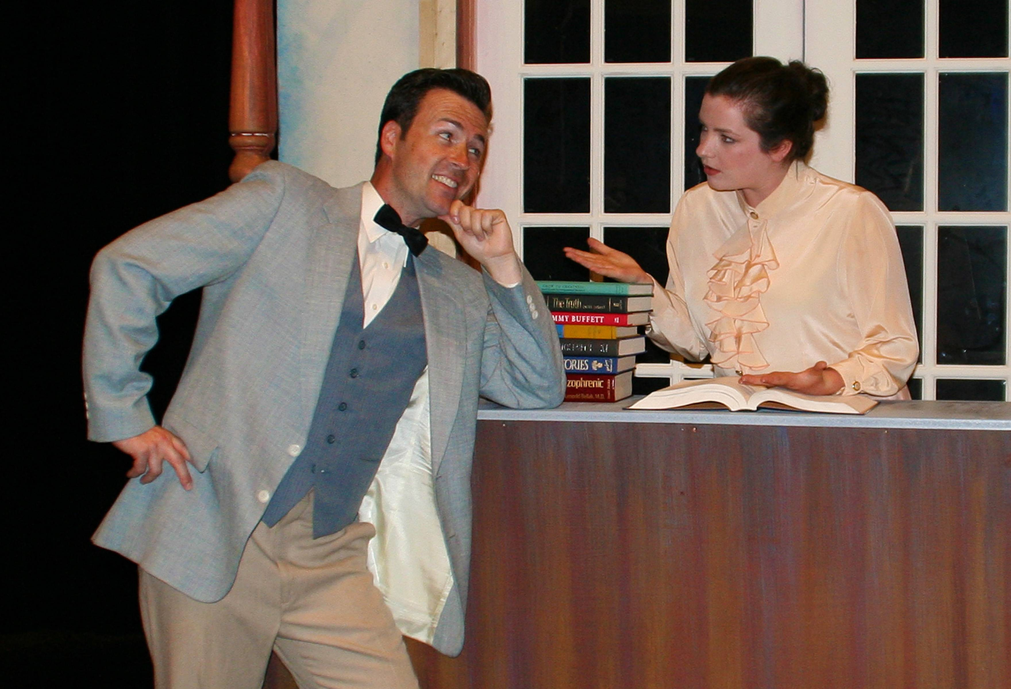 Jason Bowen (Professor Harold Hill) tries to charm Margaret Juravic (Marian the Librarian) in the Footlighters Theatre Company's production of The Music Man, July 25-August 4 at the Prairie Lakes Theatre.