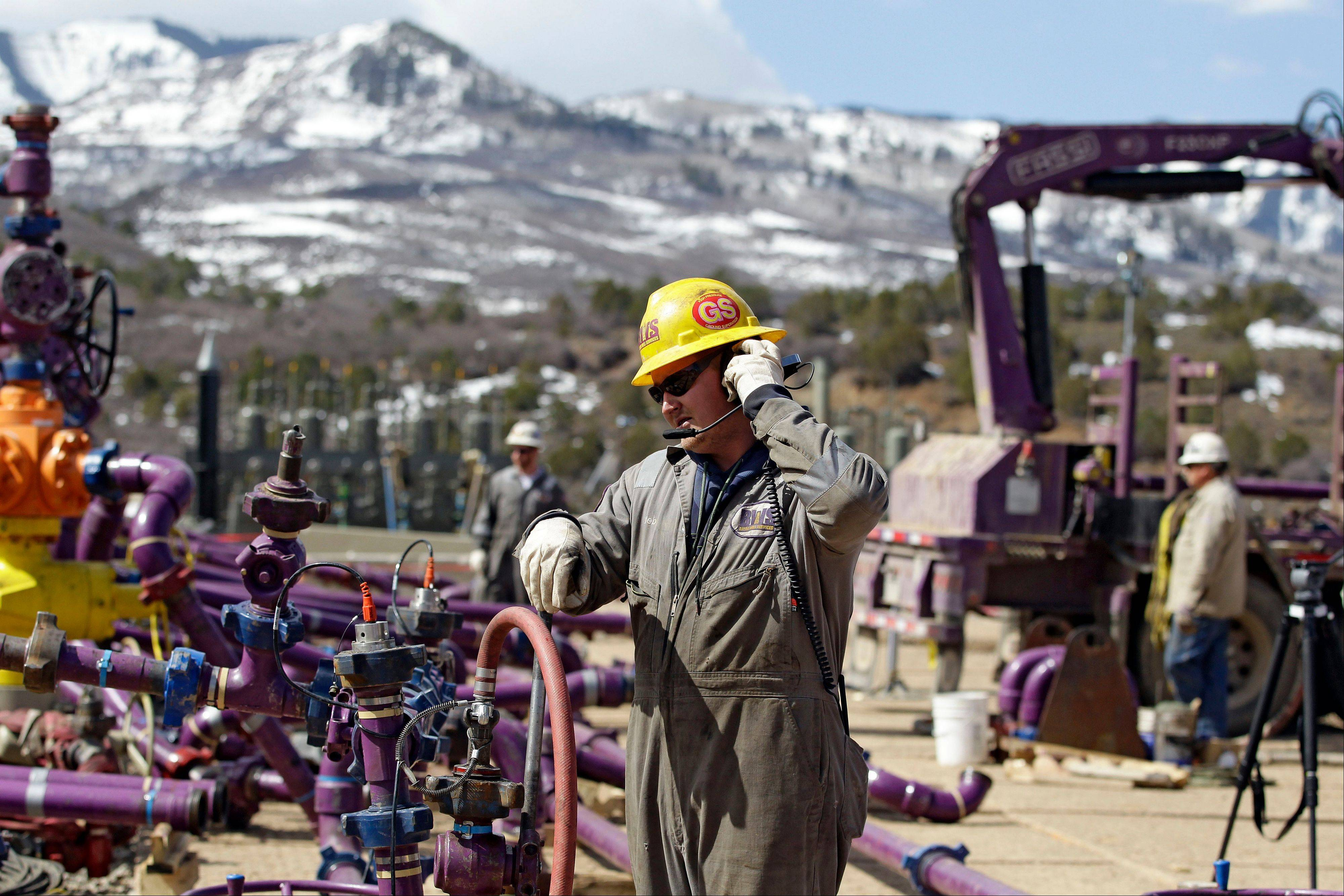 Associated Press/March 29, 2013 A worker uses a headset and microphone to communicate with coworkers over the din of pump trucks, at the site of a natural gas hydraulic fracturing and extraction operation run by the Encana Oil & Gas (USA) Inc., outside Rifle, in western Colorado.