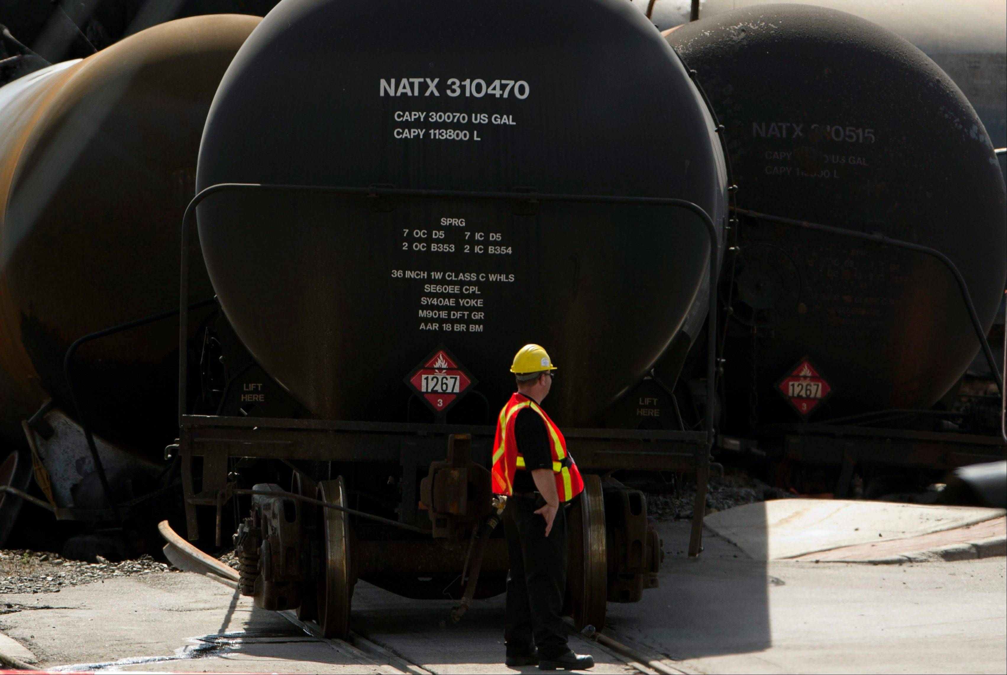 Work continues at the crash site in Lac-Megantic, Quebec of a train that derailed igniting tanker cars carrying crude oil that killed 50 people.