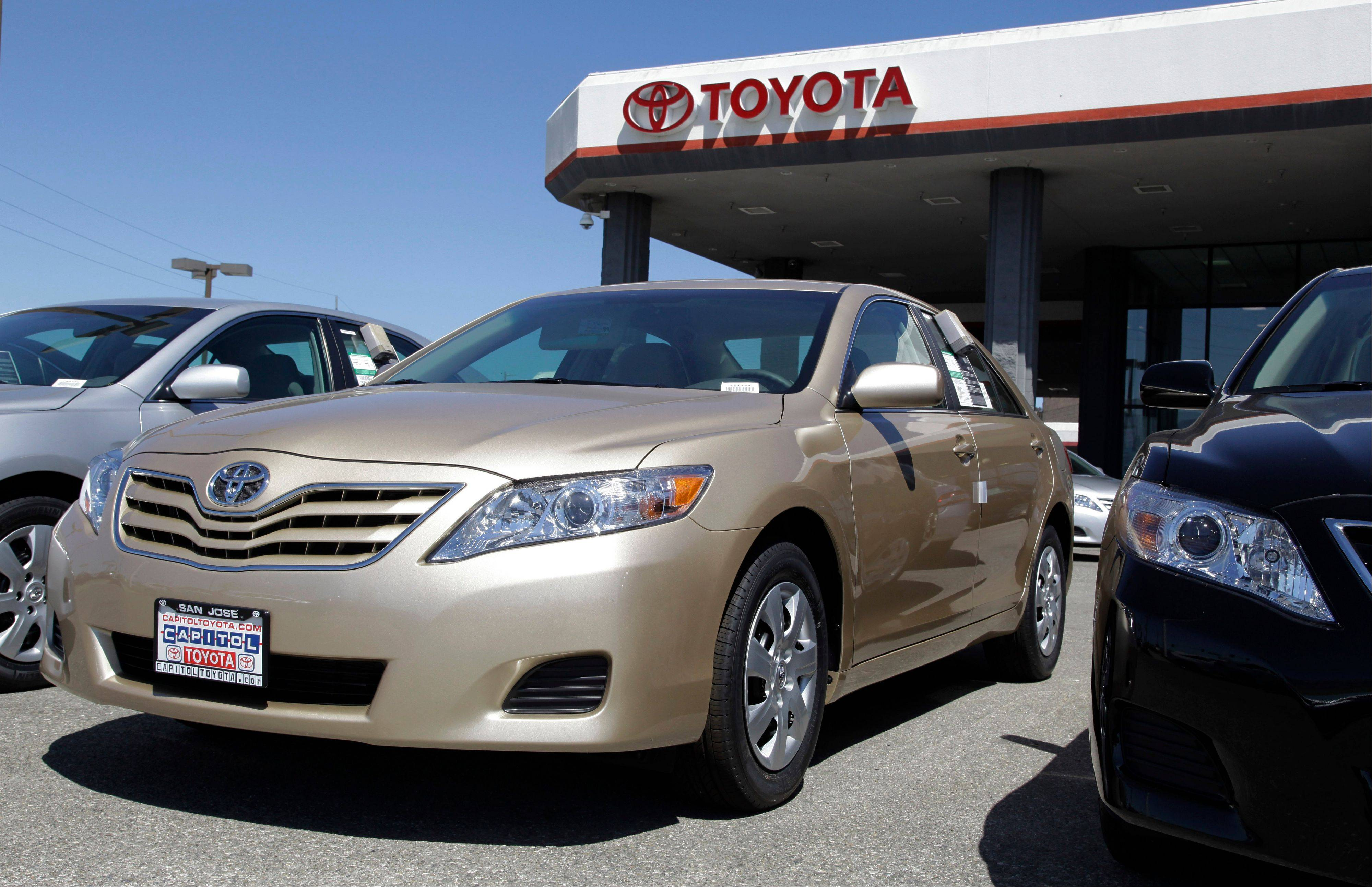 Toyota Camrys are parked at a car dealership in San Jose, Calif.