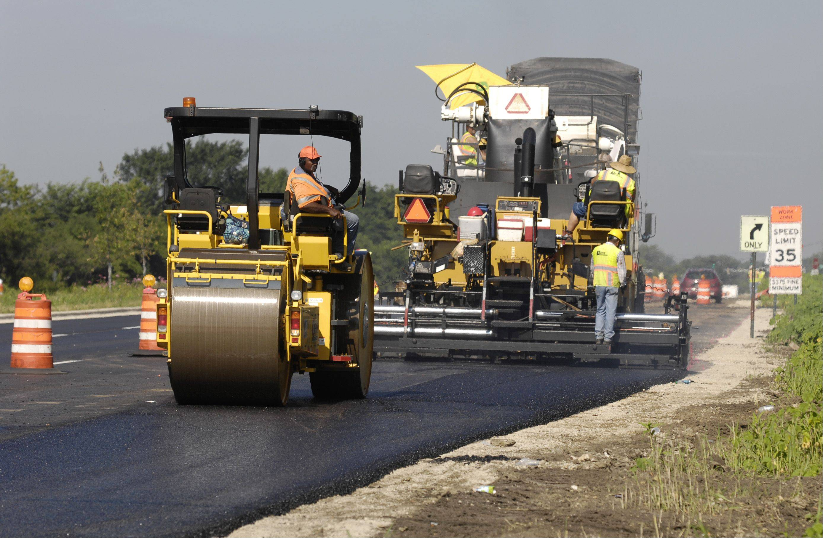 Crews spread asphalt on the westbound lanes of Butterfield Road near the intersection of Naperville Road in Wheaton.