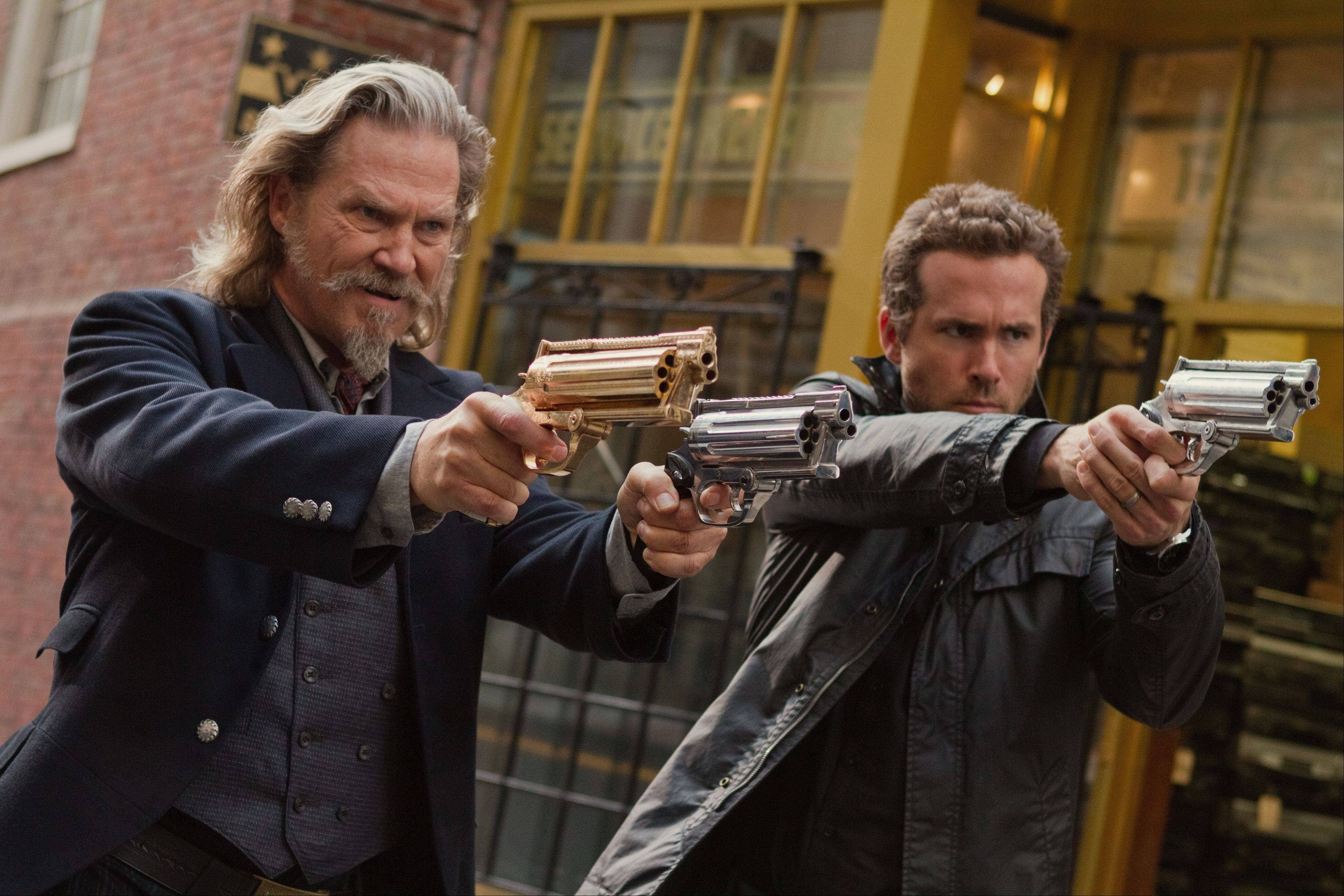 "Dead lawman Roy (Jeff Bridges) and Nick (Ryan Reynolds) seek out bad souls back on earth in ""R.I.P.D."""