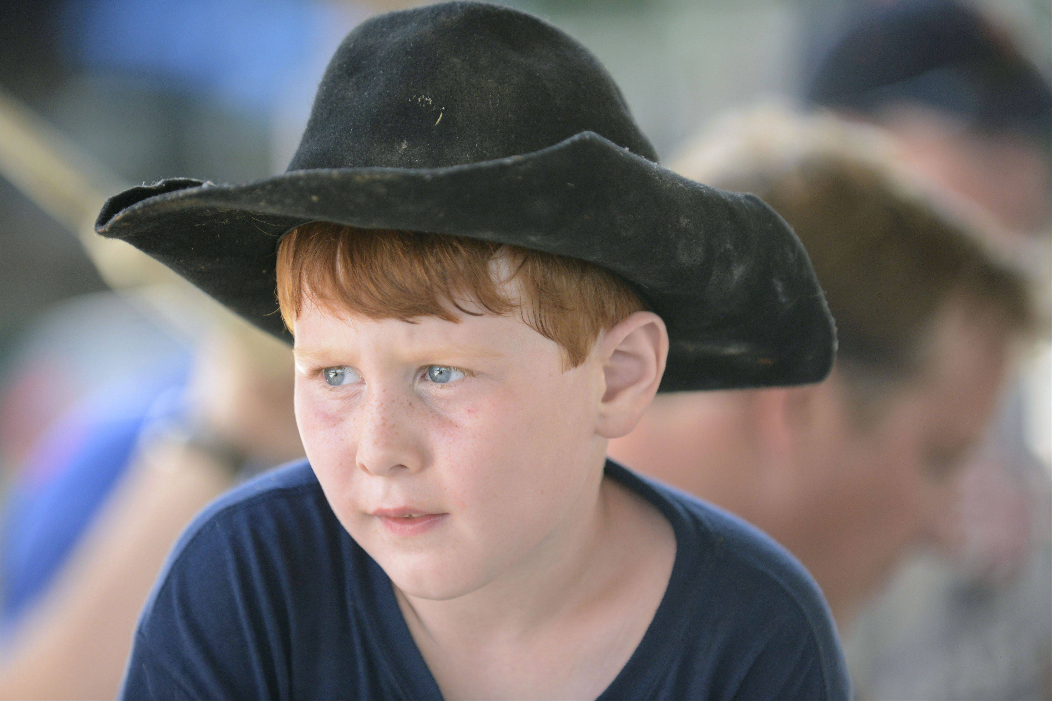 Caden Lenkaitis, 7, of Campton Hills watches dairy cattle judging Thursday. Caden�s family has been showing at the county fair for about 30 years through multiple generations.