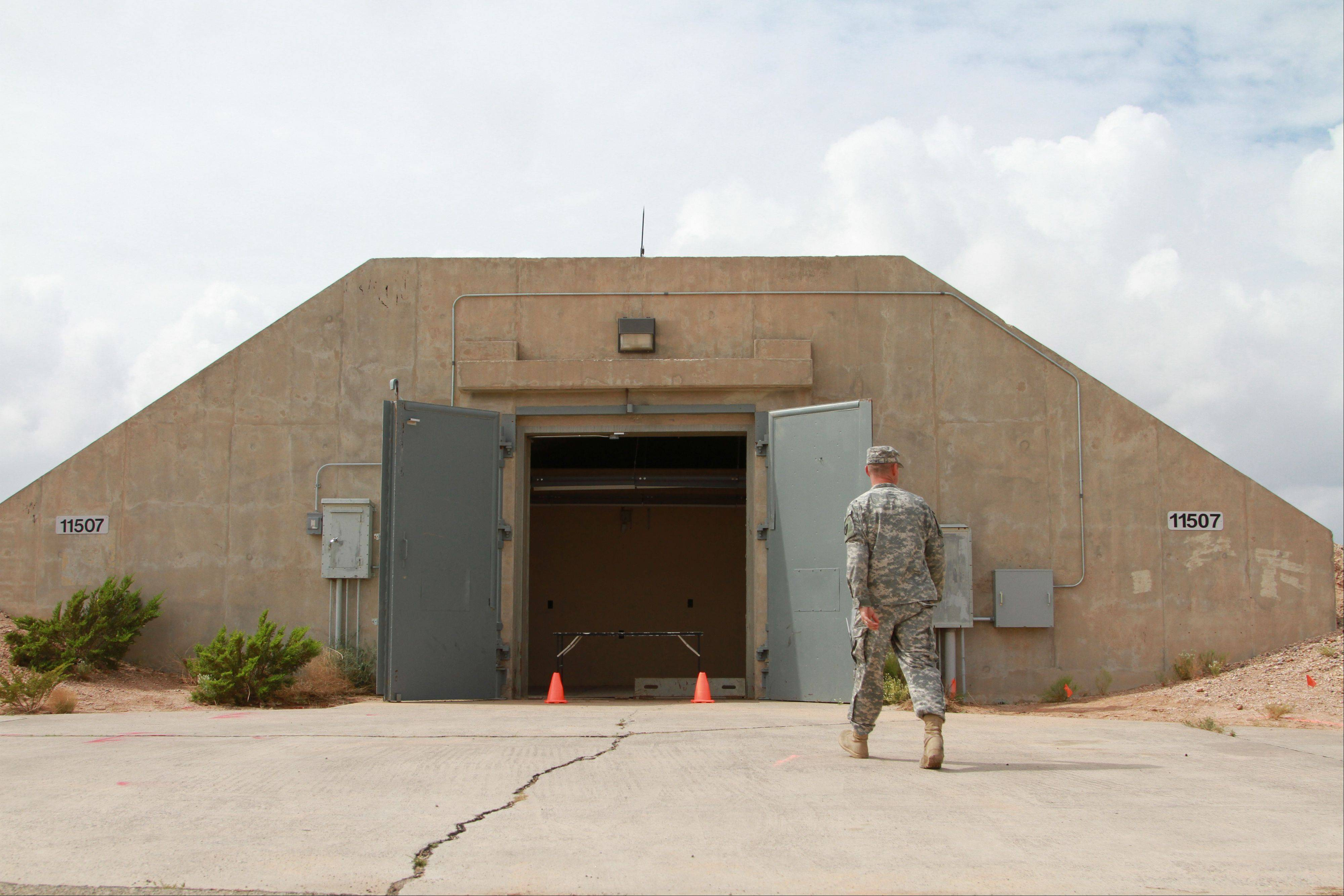 Lt. Col. Jason Crowe walks Friday toward a radiation contaminated bunker at Ft. Bliss, Texas.