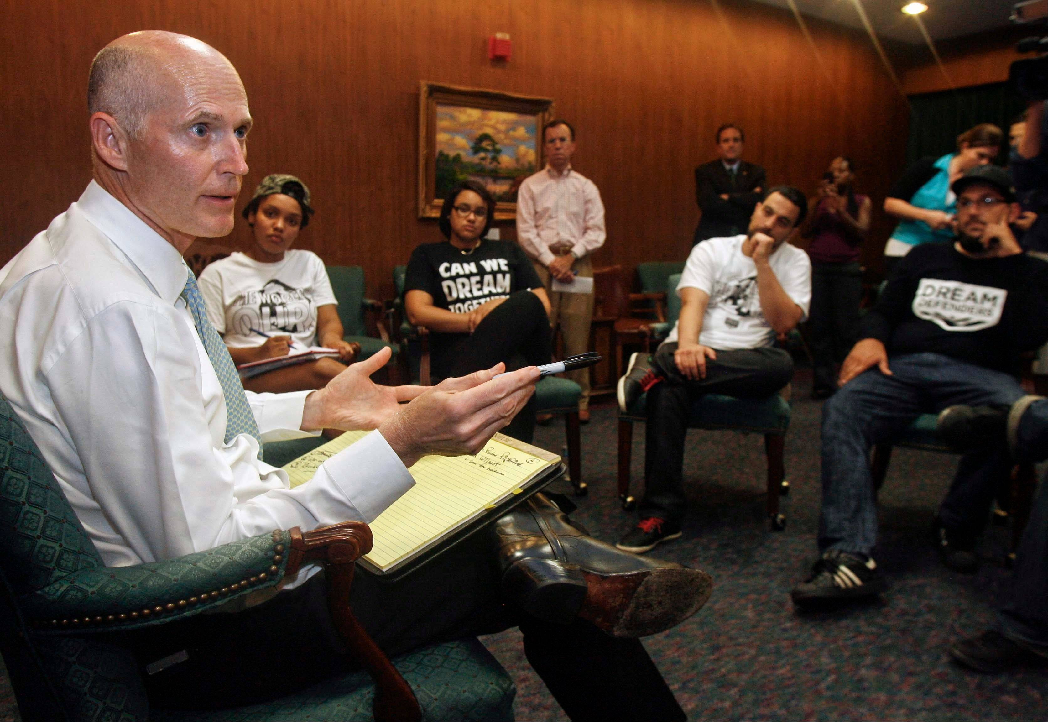 Florida Gov. Rick Scott told protesters he will not ask lawmakers to revamp the state's self-defense laws.