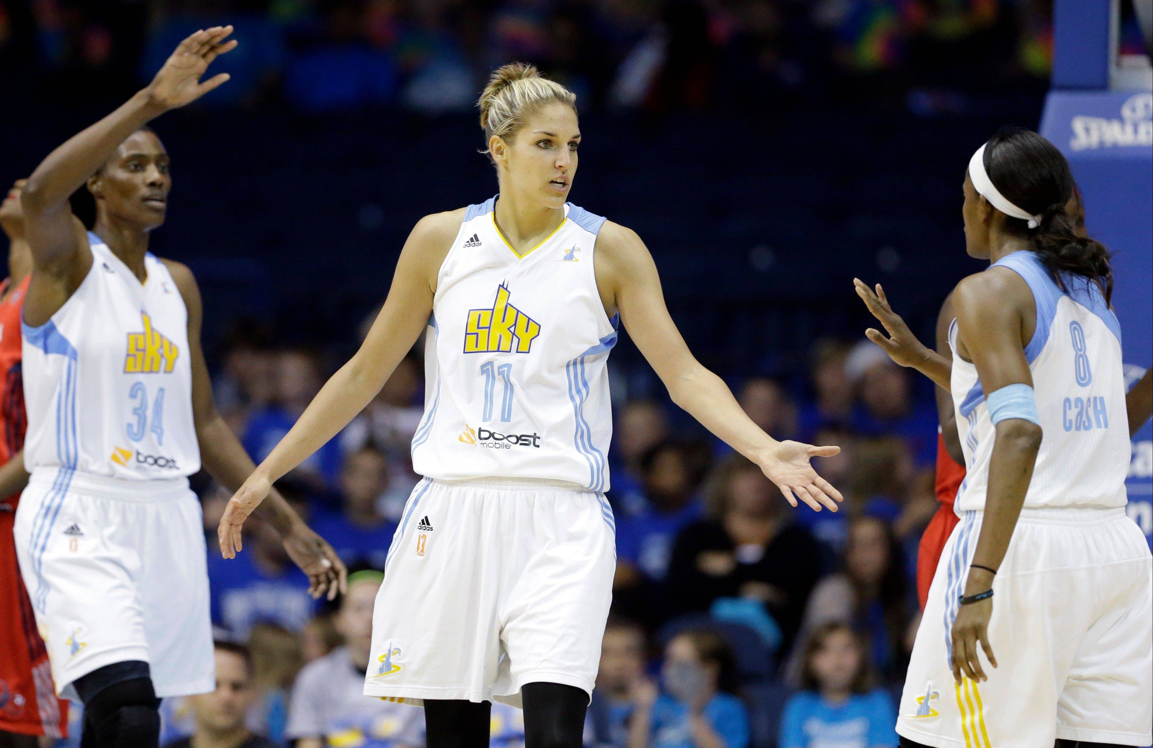 Sky forward Elena Delle Donne, center, celebrates with center Sylvia Fowles, left, and forward Swin Cash against the Washington Mystics last week. Delle Donne, a rookie, led balloting for the WNBA all-star game.