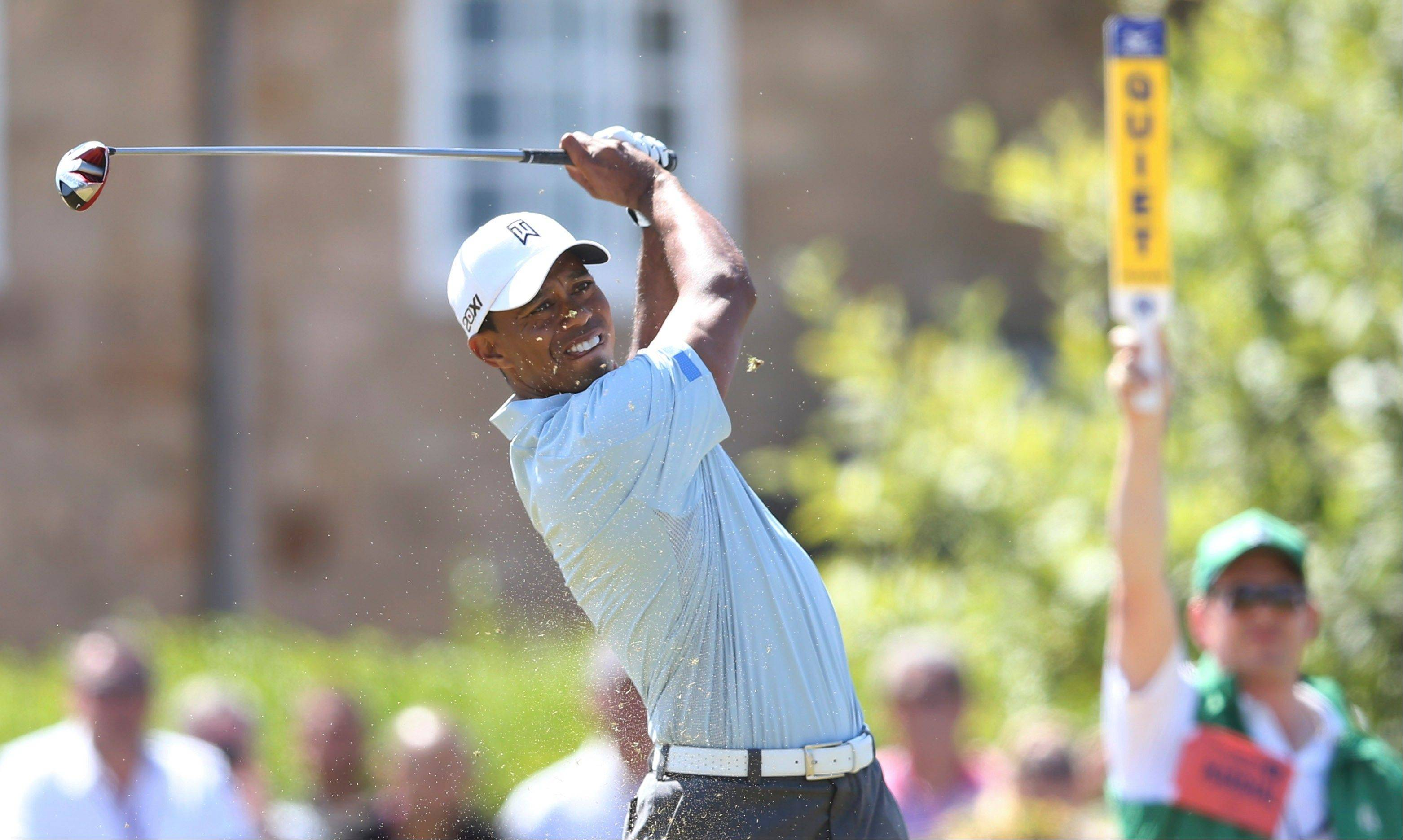 Tiger Woods plays a shot off the 10th tee Friday during the second round of the British Open at Muirfield, Scotland.