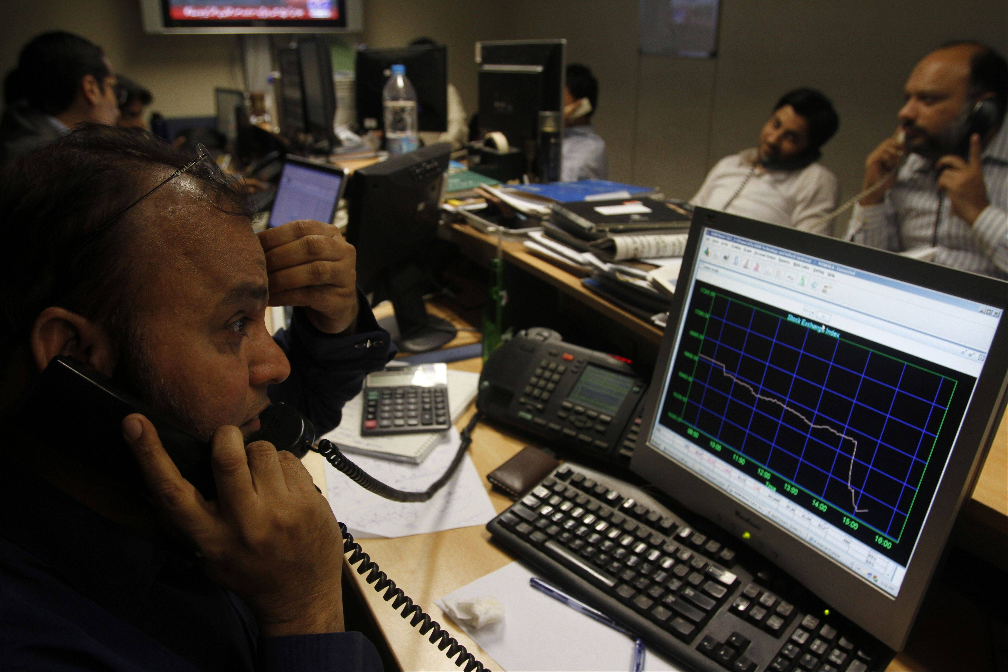 Associated Press/Jan. 15, 2013Pakistani stock brokers monitor a market at the Karachi Stock Exchange in Karachi, Pakistan.