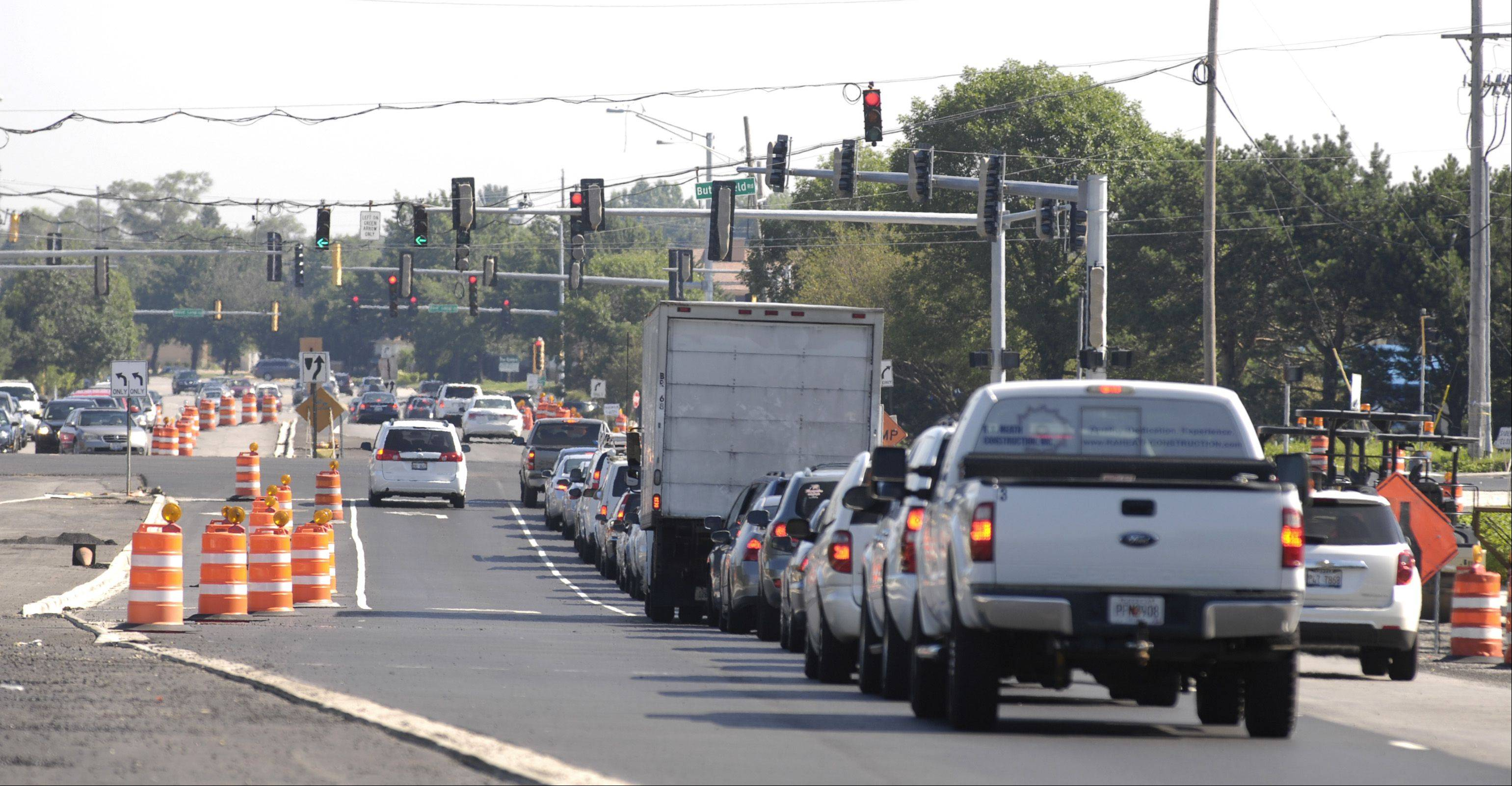 Construction work along Naperville Road near the intersection of Butterfield Road in Wheaton has caused traffic delays and frustrated area business owners.