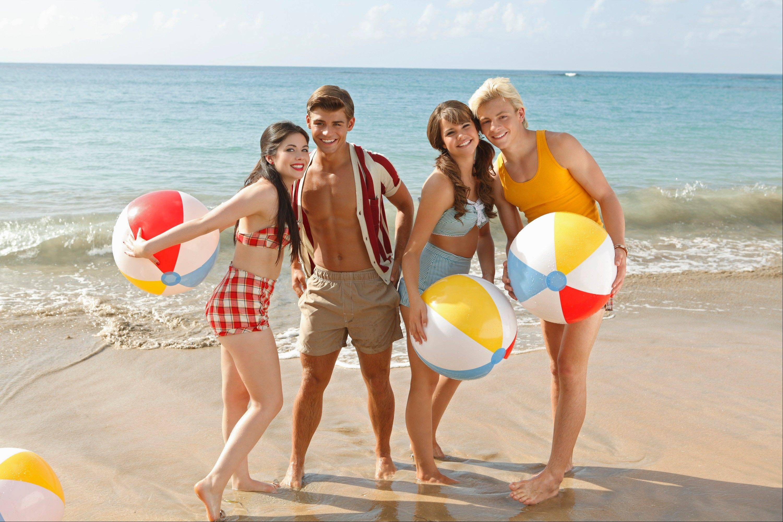 "Grace Phipps as Lela, Garrett Clayton as Tanner, Maia Mitchell as McKenzie and Ross Lynch as Brady appear in ""Teen Beach Movie."" The film, a modern take on classic beach party movies."