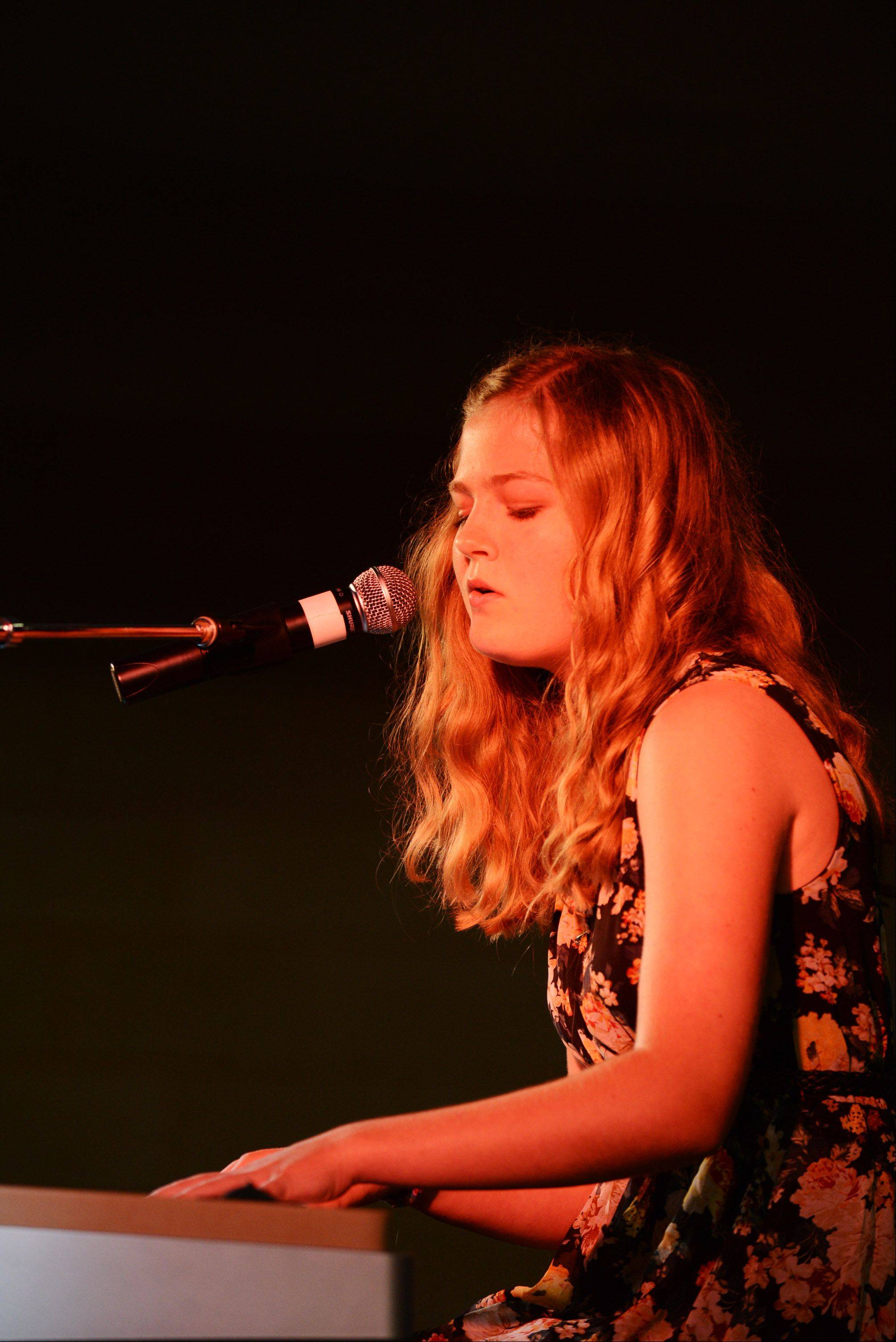 "Erin Newman, 14, of St. Charles sings ""I will Always Love You"" while accompanying herself on the piano on Monday during the annual talent show."