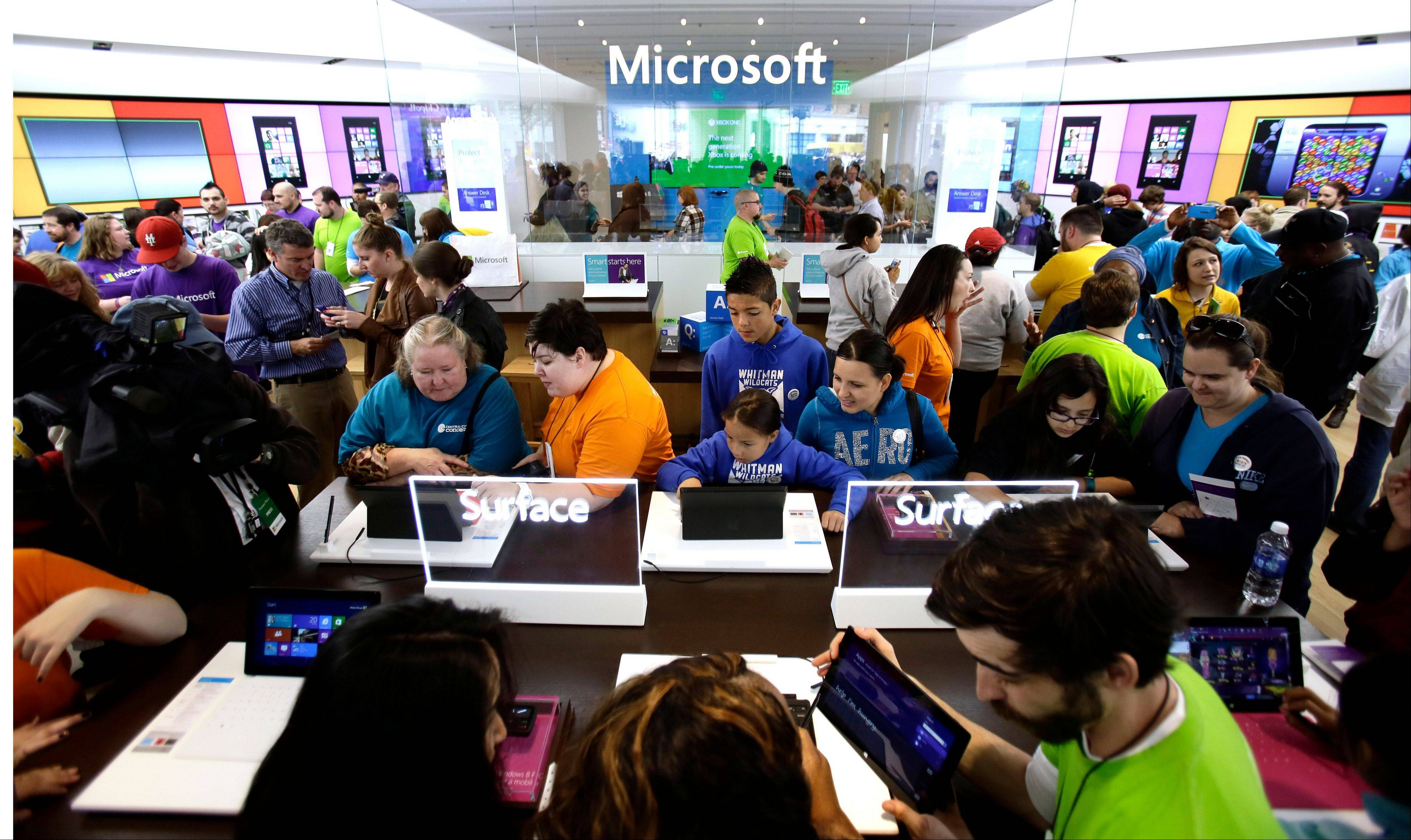 Associated Press/June 20, 2013People crowd the aisles during the grand opening of a Microsoft retail store in downtown Portland, Ore.