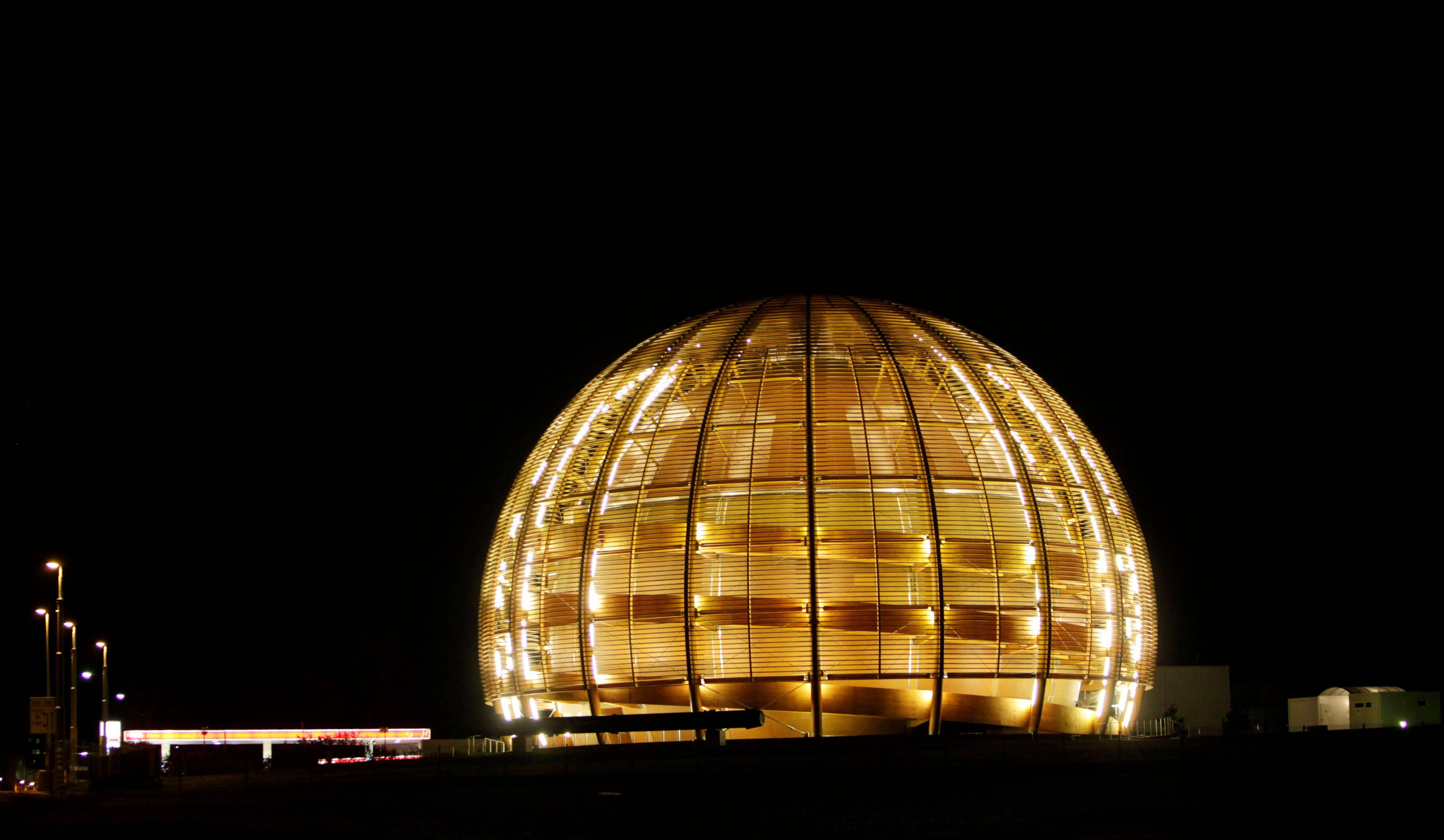 The globe of the European Organization for Nuclear Research, CERN, is illuminated outside Geneva, Switzerland.