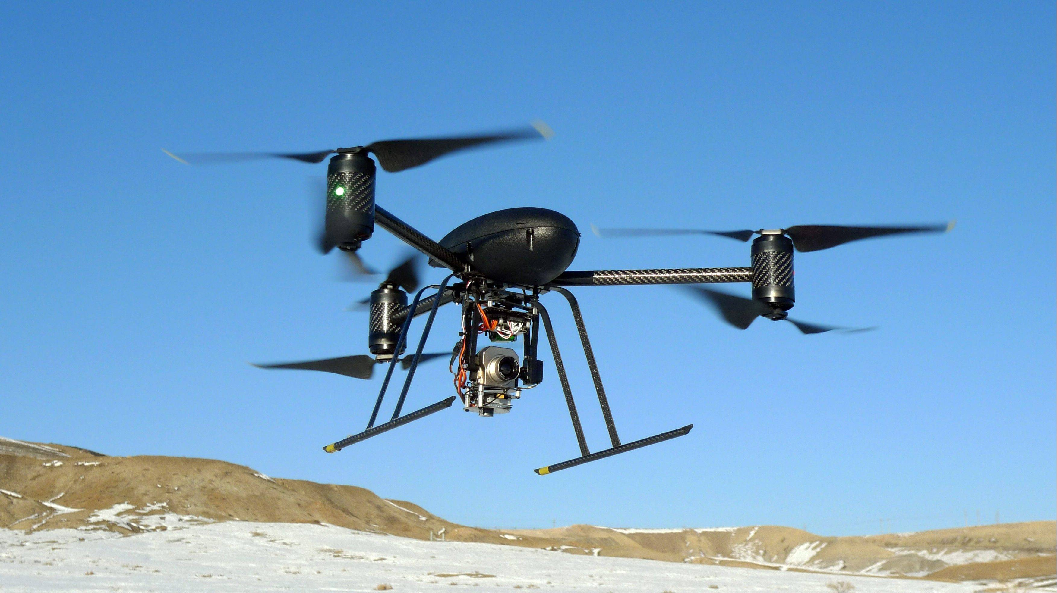 Associated Press/Jan. 8, 2009A small Draganflyer X6 drone is photographed during a test flight in Mesa County, Colo.