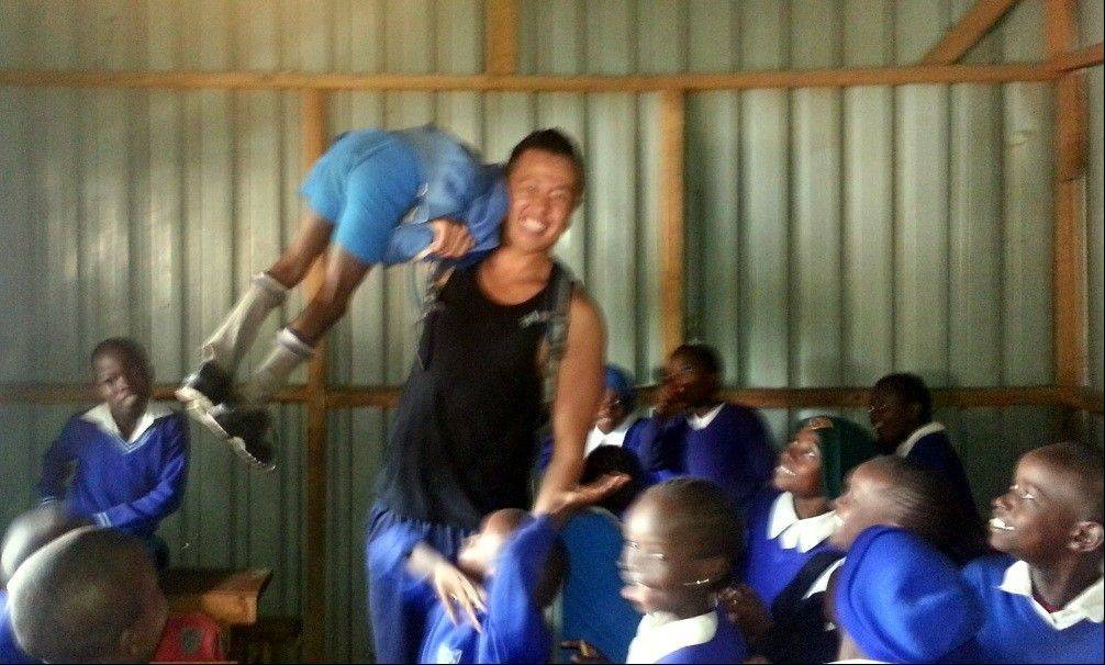 Sonny horseplaying with children at the school in the Kibera slums.