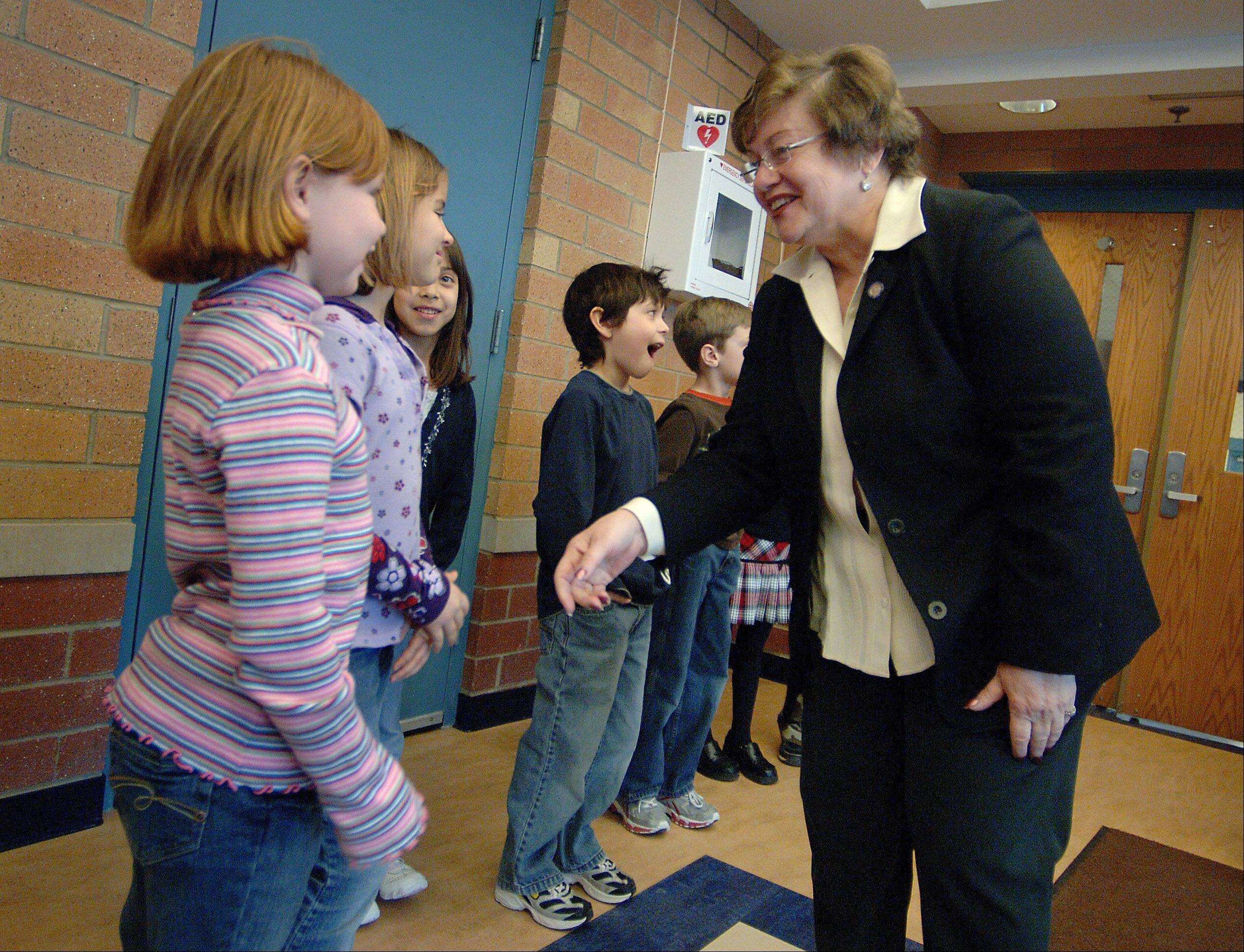 State Rep. JoAnn Osmond, here visiting with students and officials at Hillcrest School in Antioch, won't seek re-election next year.