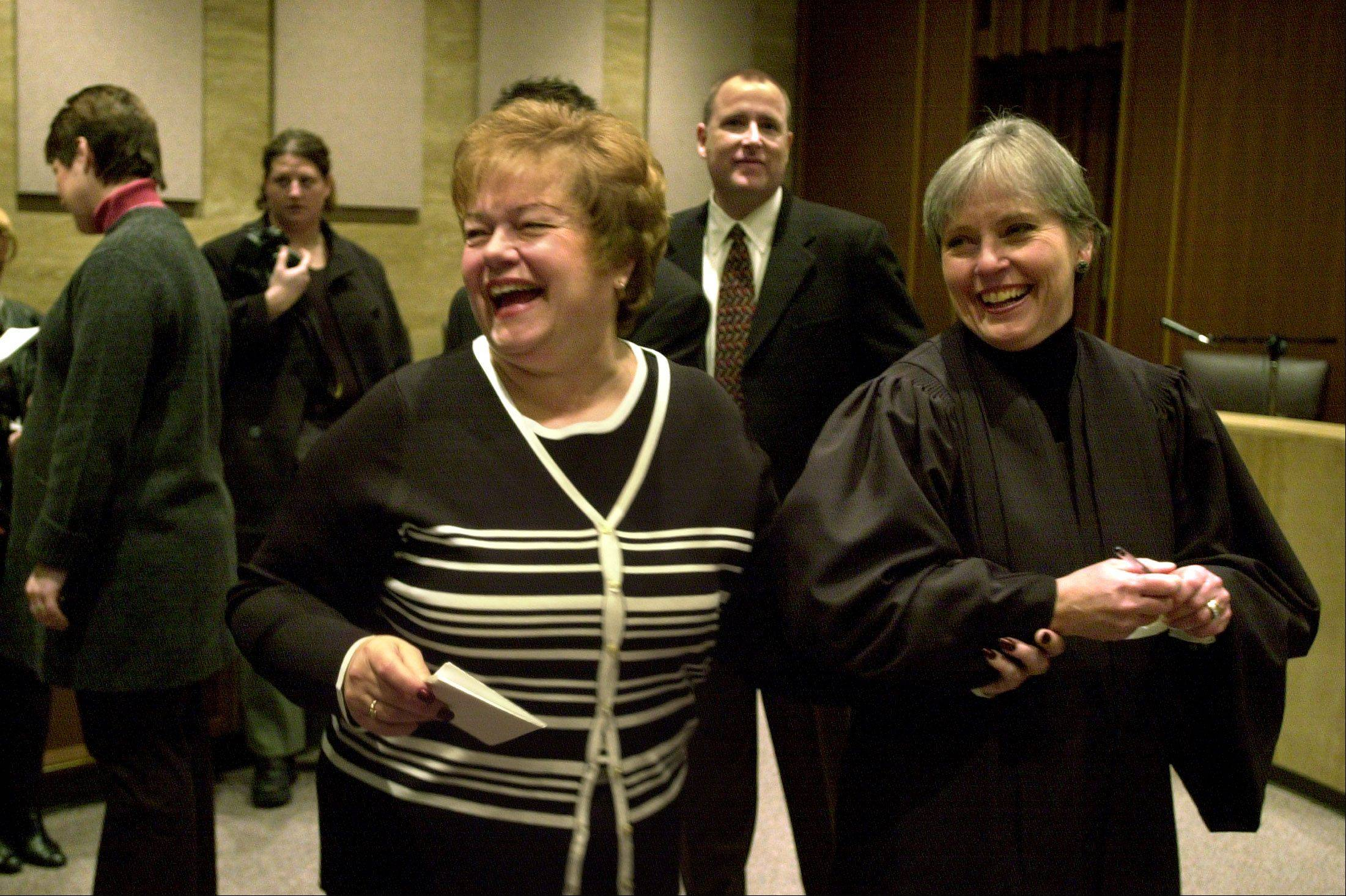 JoAnn Osmond, left, was sworn in by then-Chief Judge Jane Waller in 2002. Osmond has decided not to seek re-election in 2014.