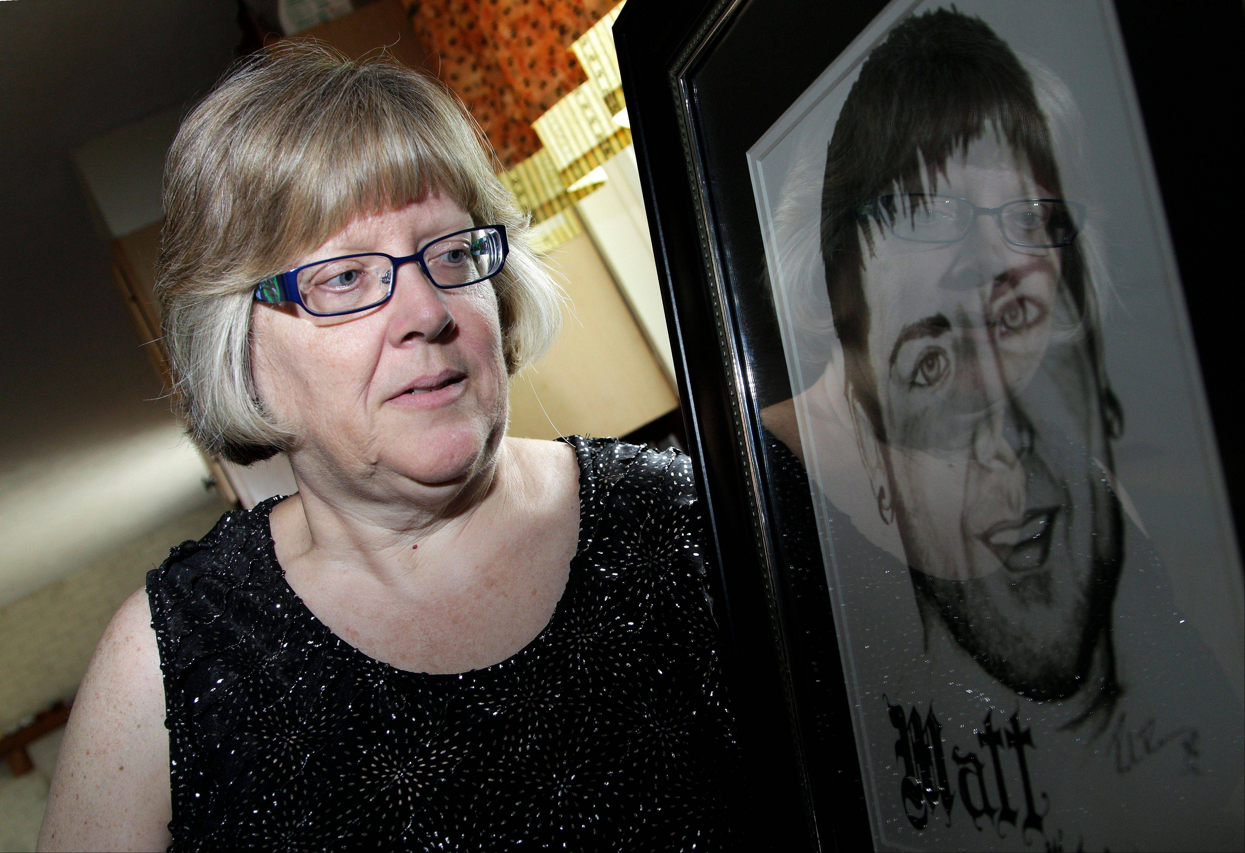Jerri Jackson, mother of Aurora, Colo. theater shooting victim Matthew McQuinn, stands next to a sketch of her son. Jackson remembers a conversation she had with her son hours before the shooting. He talked about plans to move back to Ohio to work at a car parts factory near St. Paris; perhaps he would marry his girlfriend. Then McQuinn said he had to go. He was going to the movies.